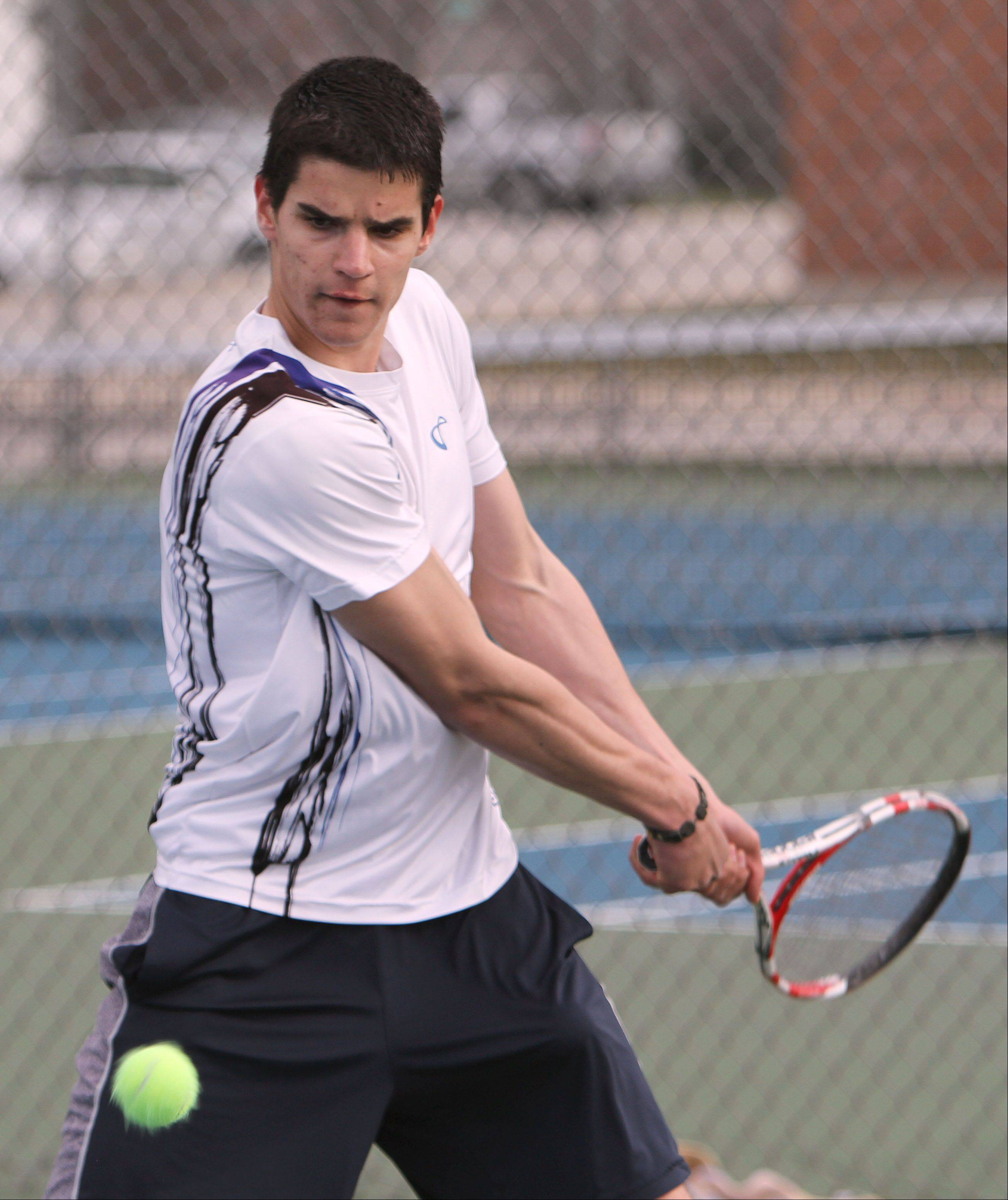 Warren's Kristiyan Trukov returns a shot during his match against Stevenson's Jeremy Bush on Tuesday.