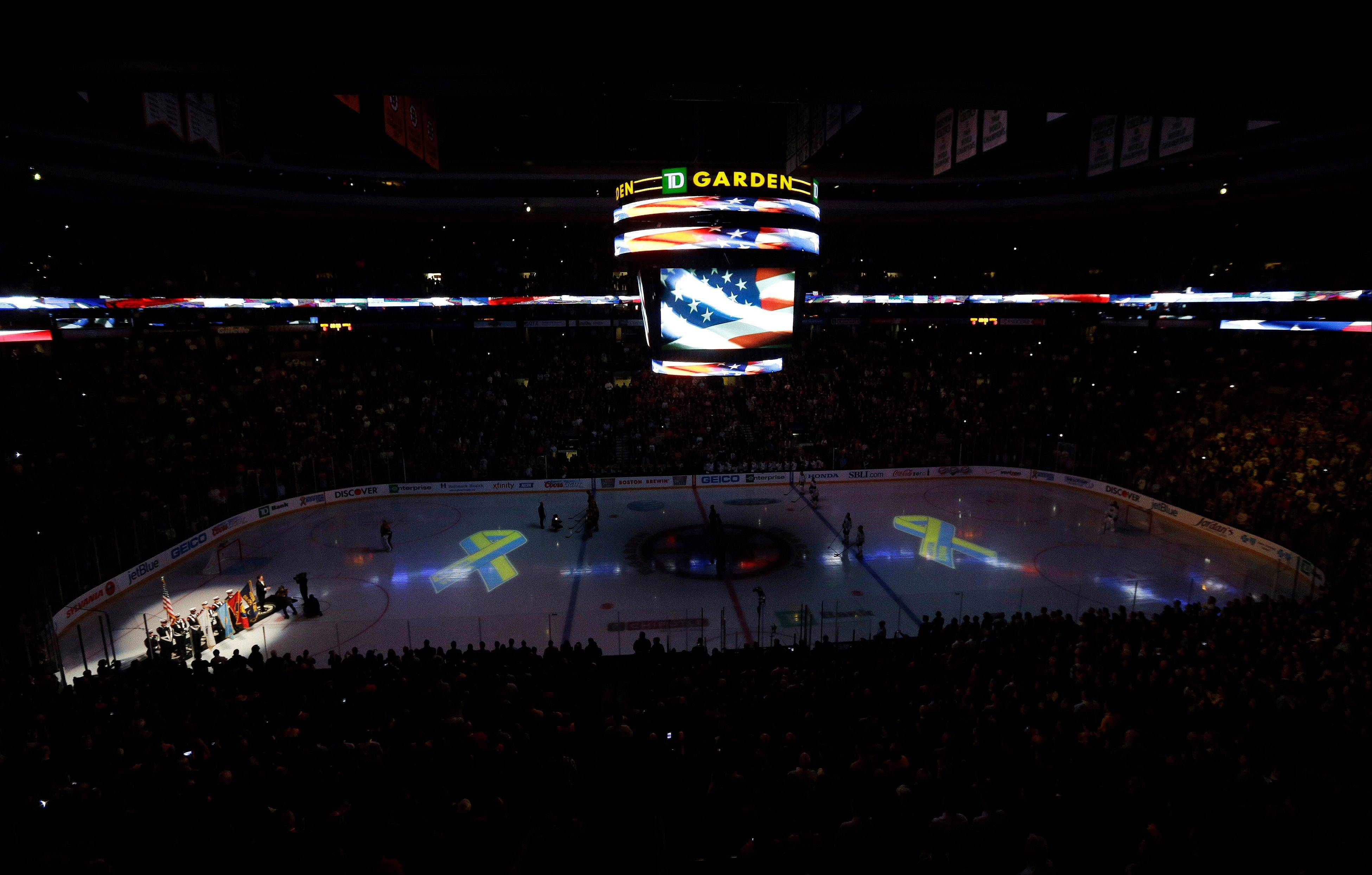 Members of a Boston Fire Department honor guard hold flags during the singing of the national anthem at TD Garden in Boston, Wednesday, April 17, 2013, during a pregame ceremony in the aftermath of Monday's Boston Marathon bombings.