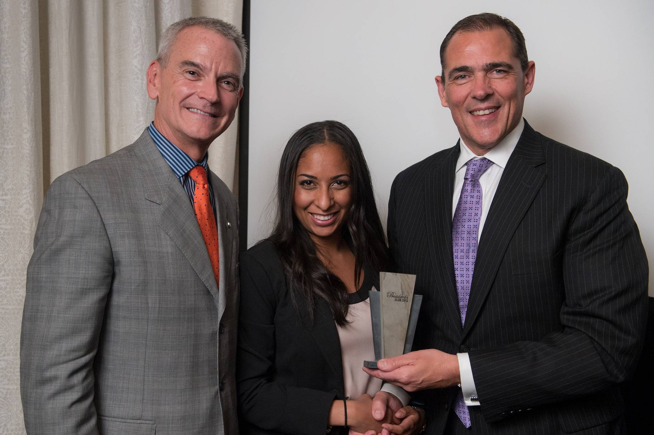 From left to right: James S. Metcalf, USG Corporation chairman, president and CEO; Miya Russell, architectural sales representative; Chris Griffin, executive vice president of operations, USG Corporation and president, United States Gypsum Company.