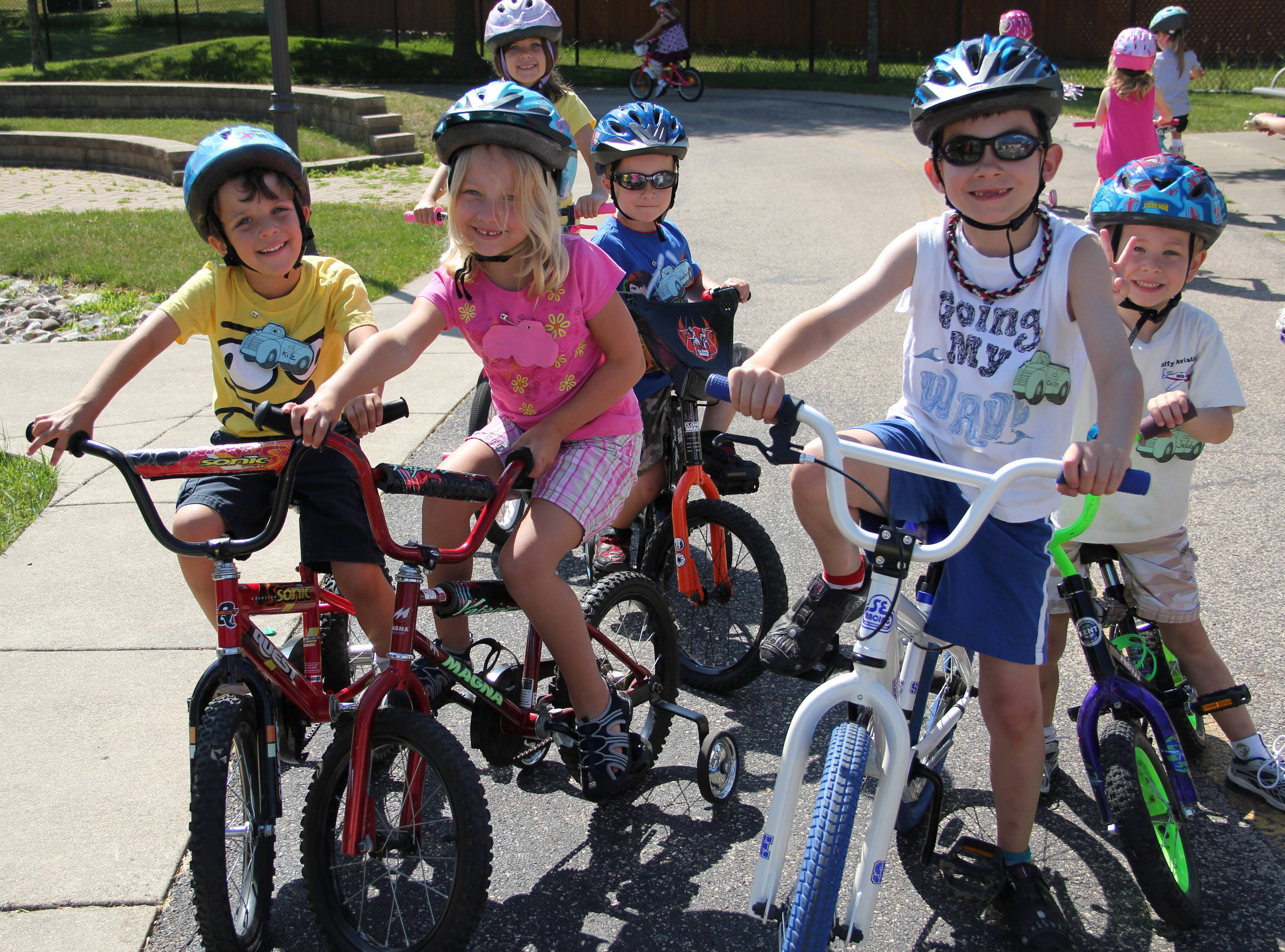 Children ride bikes and learn safety lessons at Safety Park.