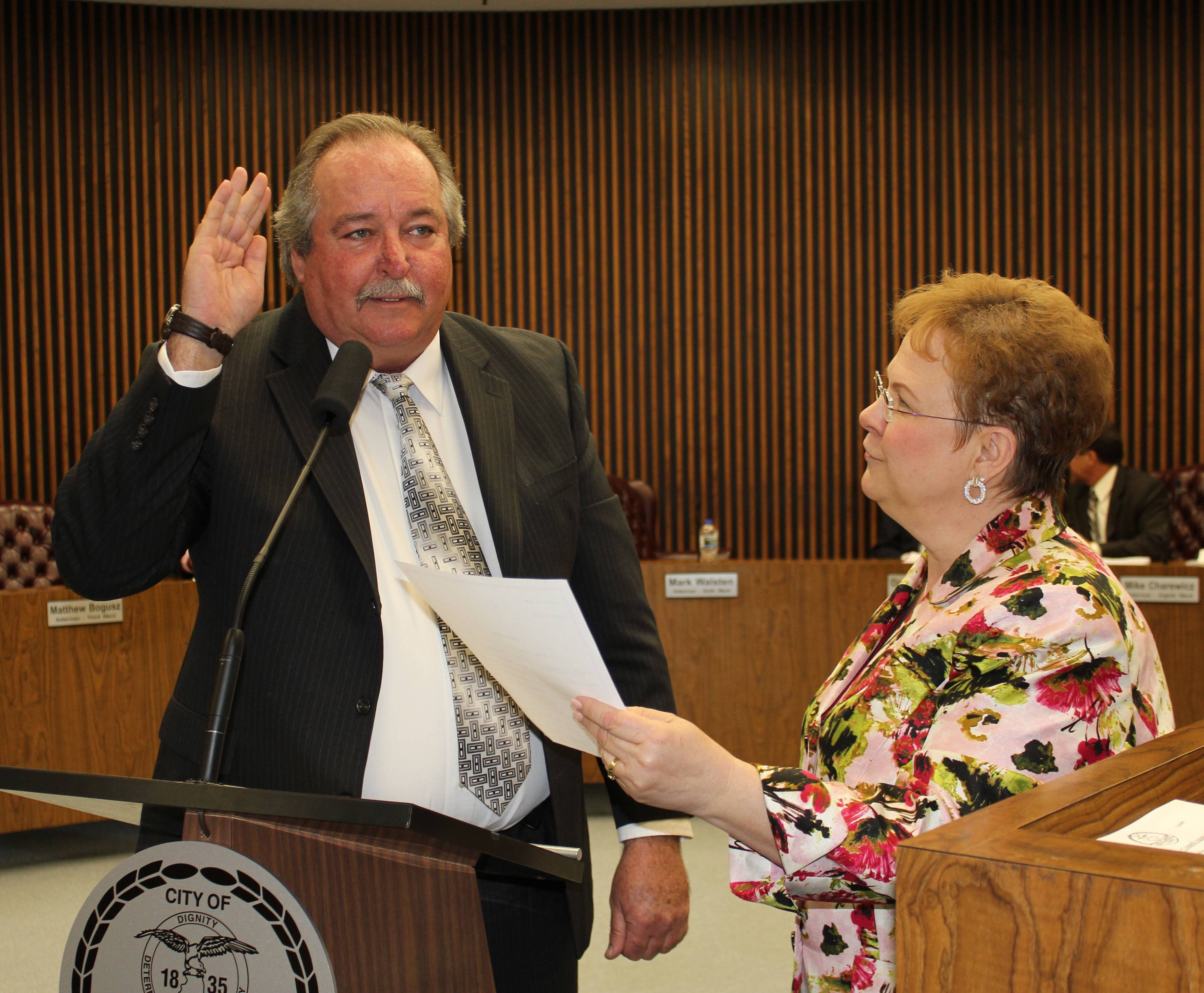 6th Ward Alderman Mark Walsten (left) is sworn in as Acting Mayor of the City of Des Plaines by City Clerk Gloria J. Ludwig (right) at the Monday, April 15, 2013, City Council Meeting at City Hall.