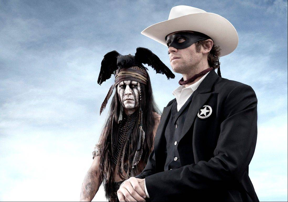 "Johnny Depp as Tonto, left, and Armie Hammer as the Lone Ranger in the film ""The Lone Ranger,"" opening July 3."