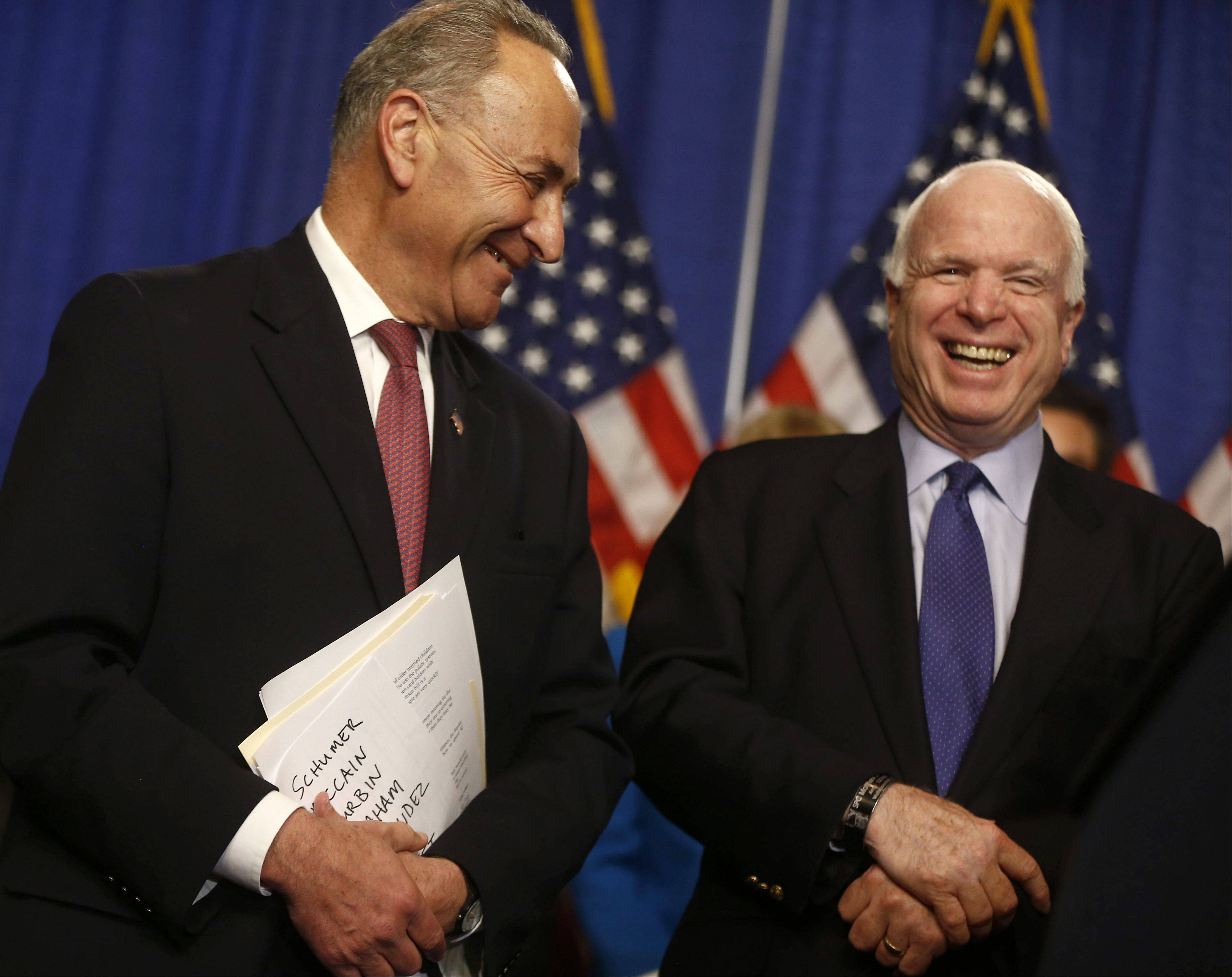 Sen. Charles Schumer, left, and Sen. John McCain discussed a wide-ranging immigration bill they helped craft with support from business executives, religious leaders, activists and others.