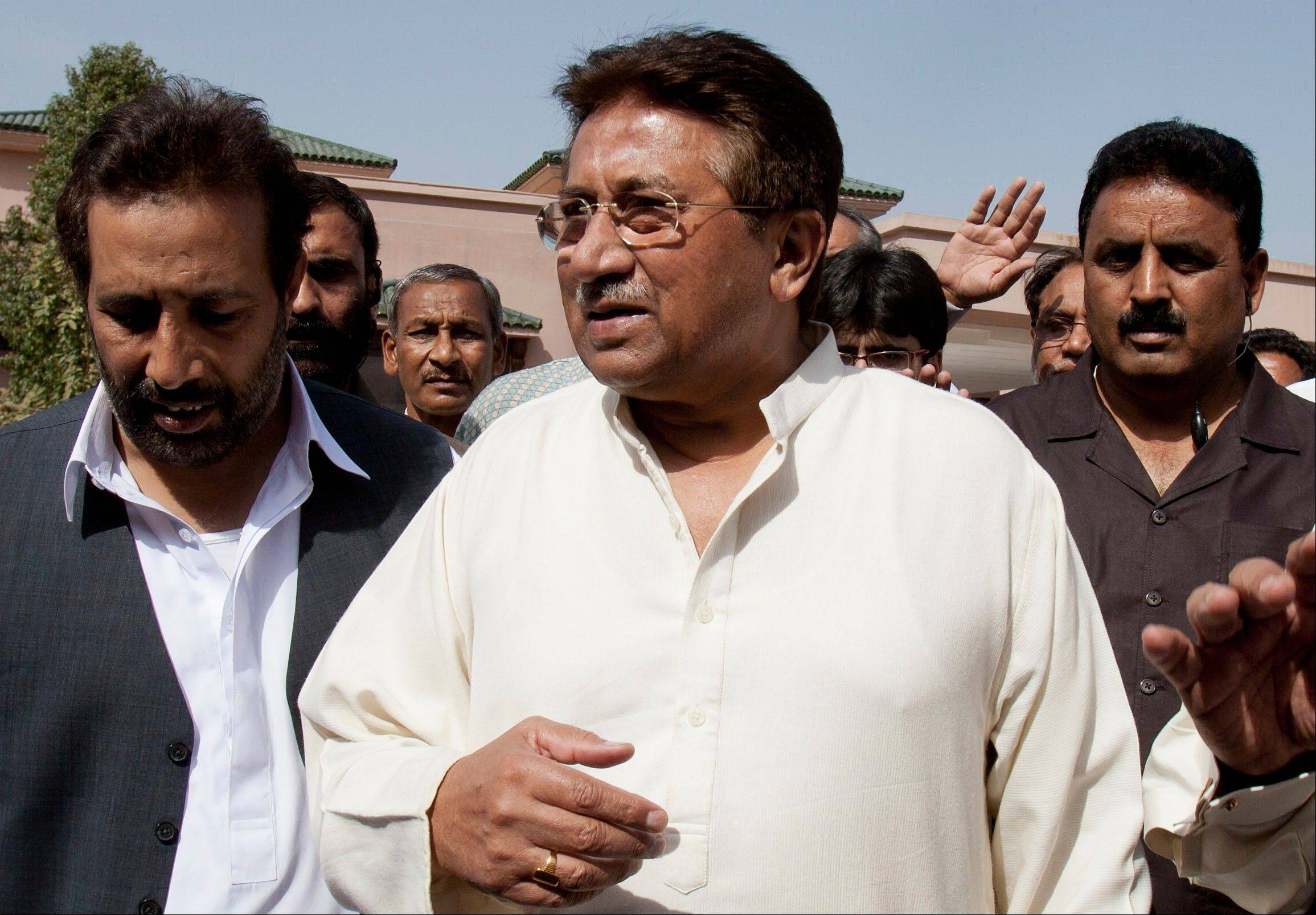 Pakistan's former President and military ruler Pervez Musharraf and his security team pushed past policemen and sped away from a court in the country's capital on Thursday after his bail was revoked in a case in which he is accused of treason.