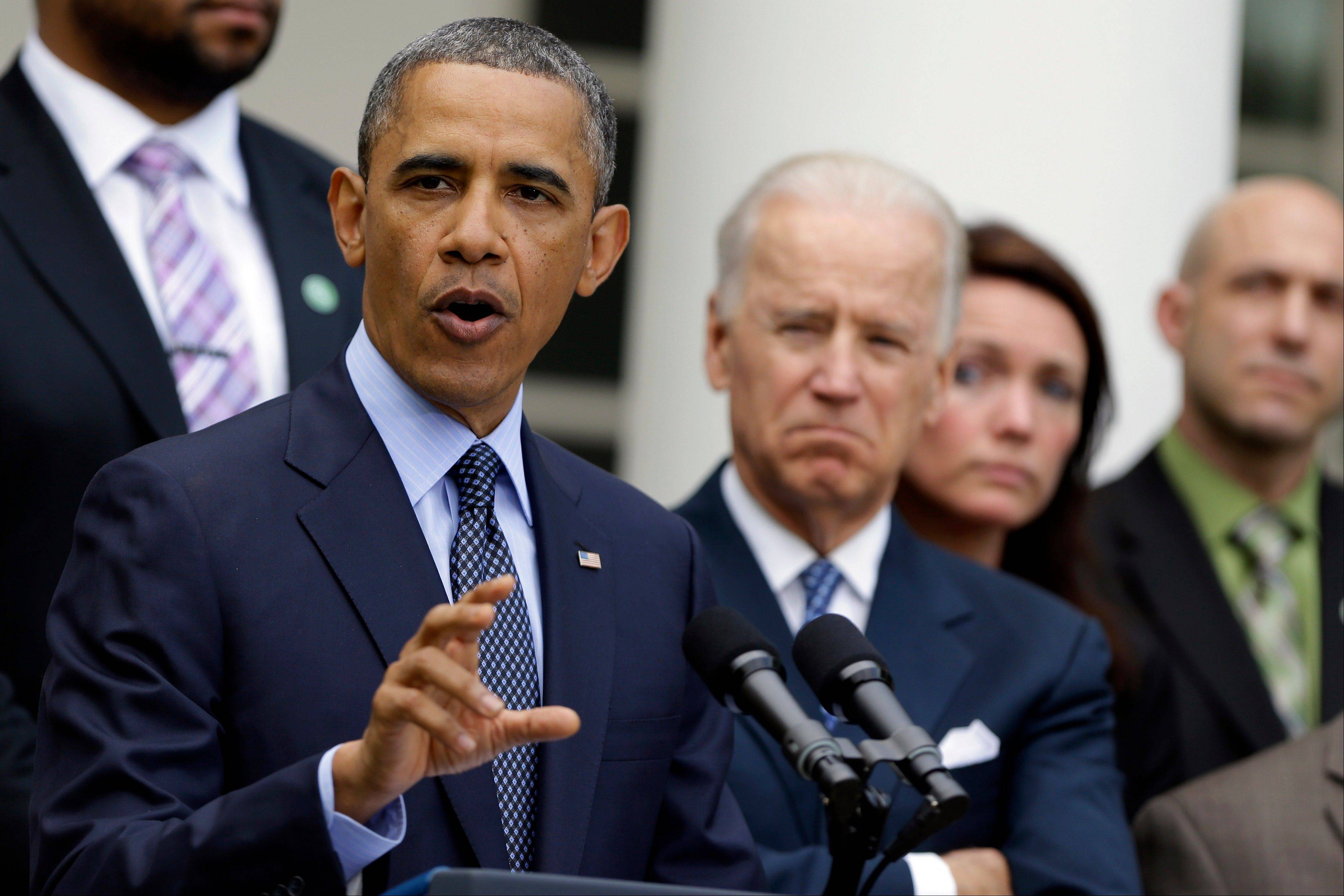 President Barack Obama, next to Vice President Joe Biden, gestures as he speaks during a news conference in the Rose Garden of the White House, in Washington, on Wednesday, April 17, 2013, about the defeat in the Senate of a bill to expand background checks on guns.