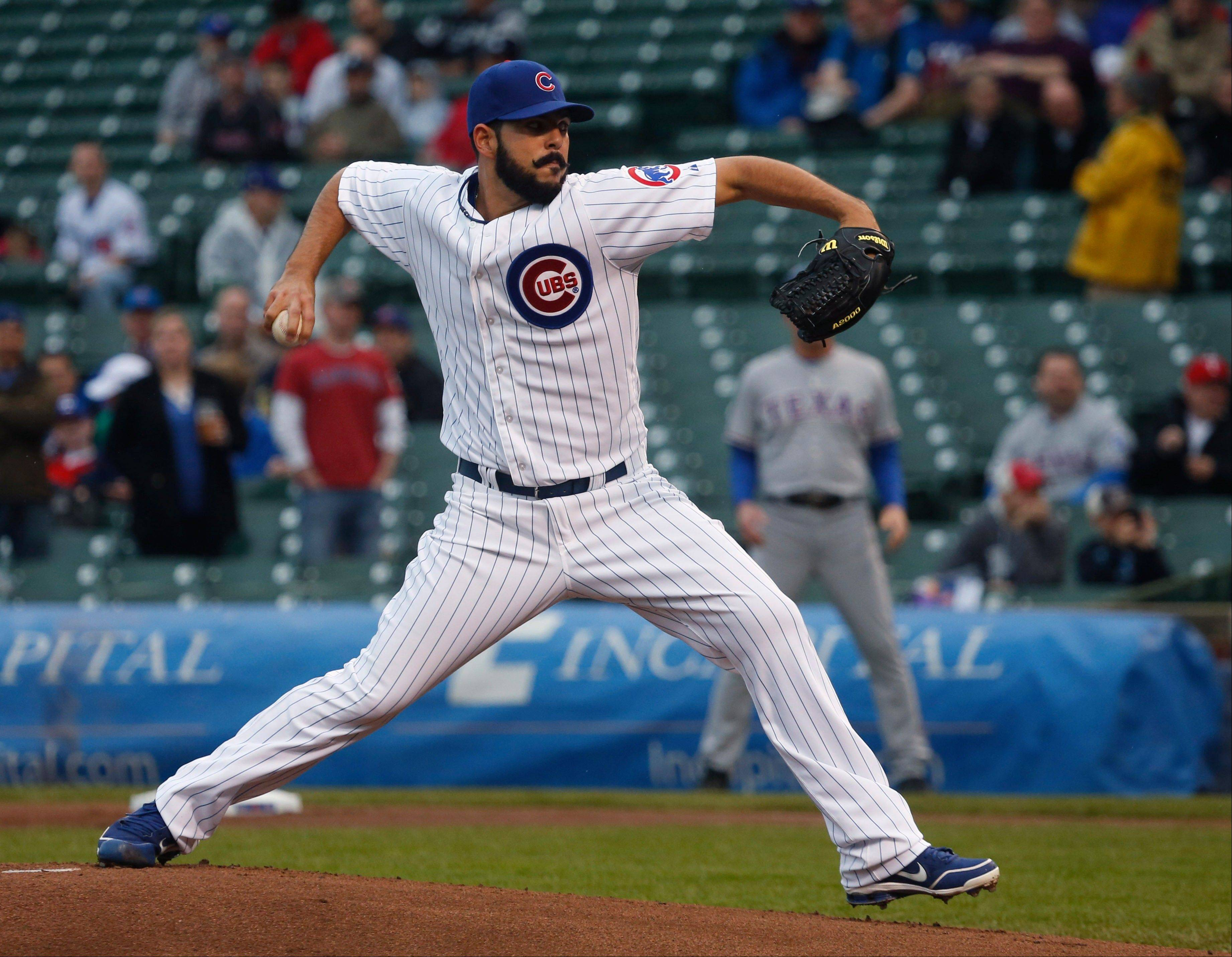 Starter Carlos Villanueva earned his first win as a Cub, lowering his ERA to 1.29.