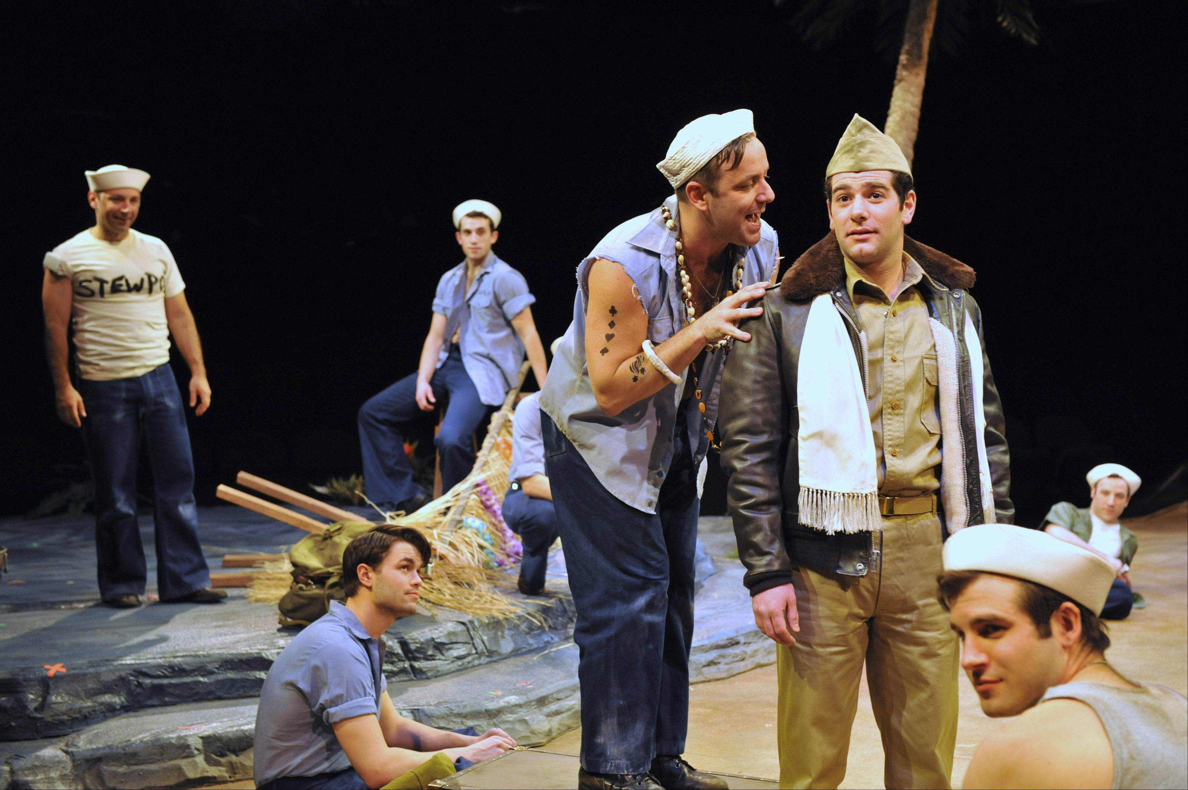 "Luther (Stef Tovar, second from right) tries to entice Lt. Cable (Ben Jacoby) to take a trip to Bali Ha'i in Marriott Theatre's ""South Pacific."""