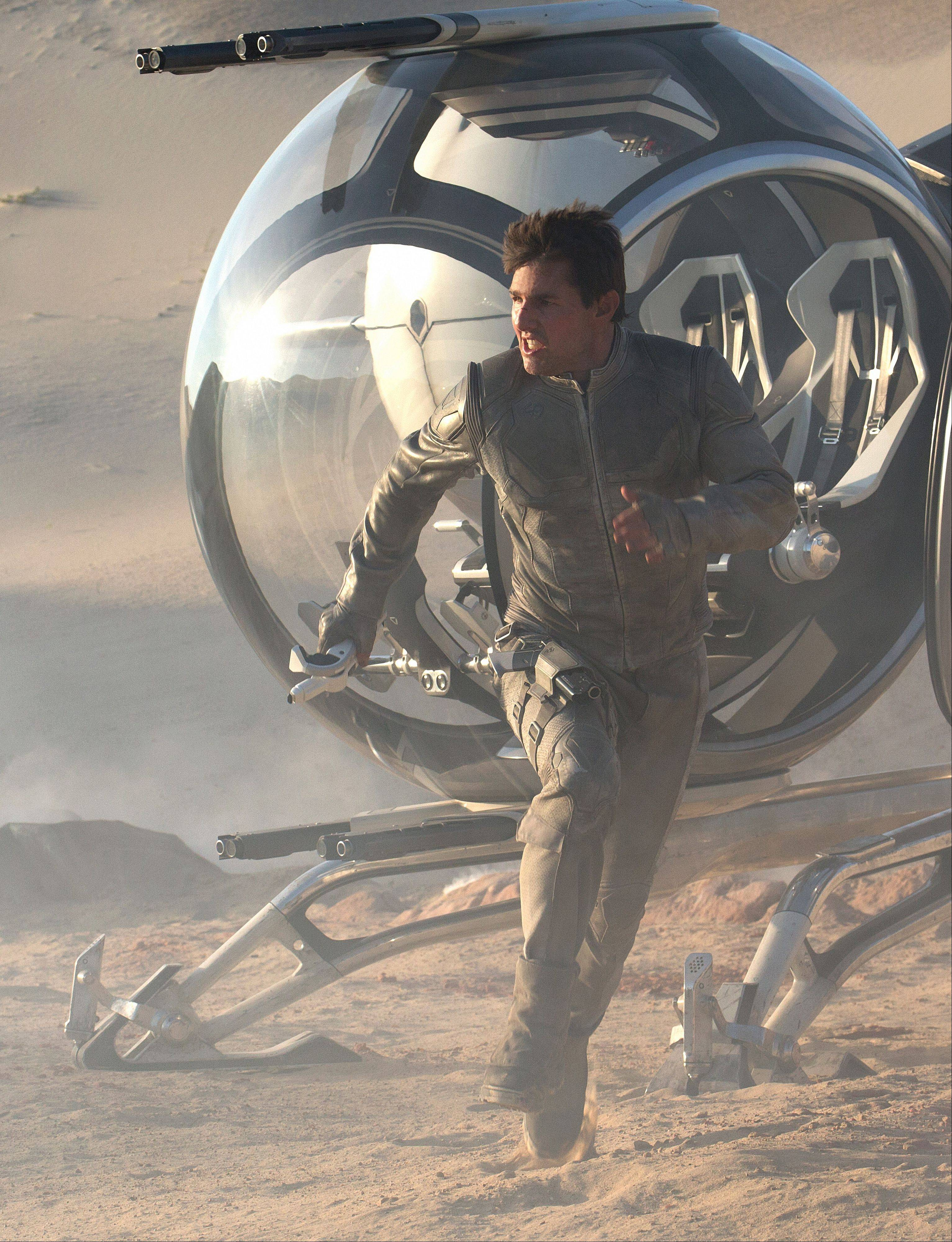 "Jack (Tom Cruise) goes into action mode -- again -- in the futuristic thriller ""Oblivion."""