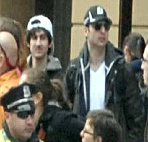 This photo released by the FBI early Friday April 19, 2013, shows what the FBI is calling the suspects together, walking through the crowd in Boston on Monday, April 15, 2013, before the explosions at the Boston Marathon.