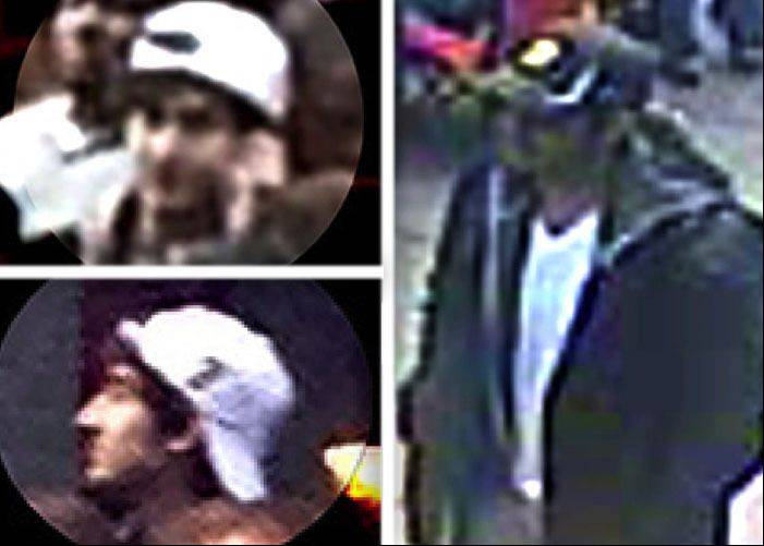A poster released by the FBI on Thursday, April 18, 2013, shows what the FBI are calling suspects numbered 1, right, and number 2, left, walking through the crowd in Boston on Monday, April 15, 2013, before the explosions at the Boston Marathon.