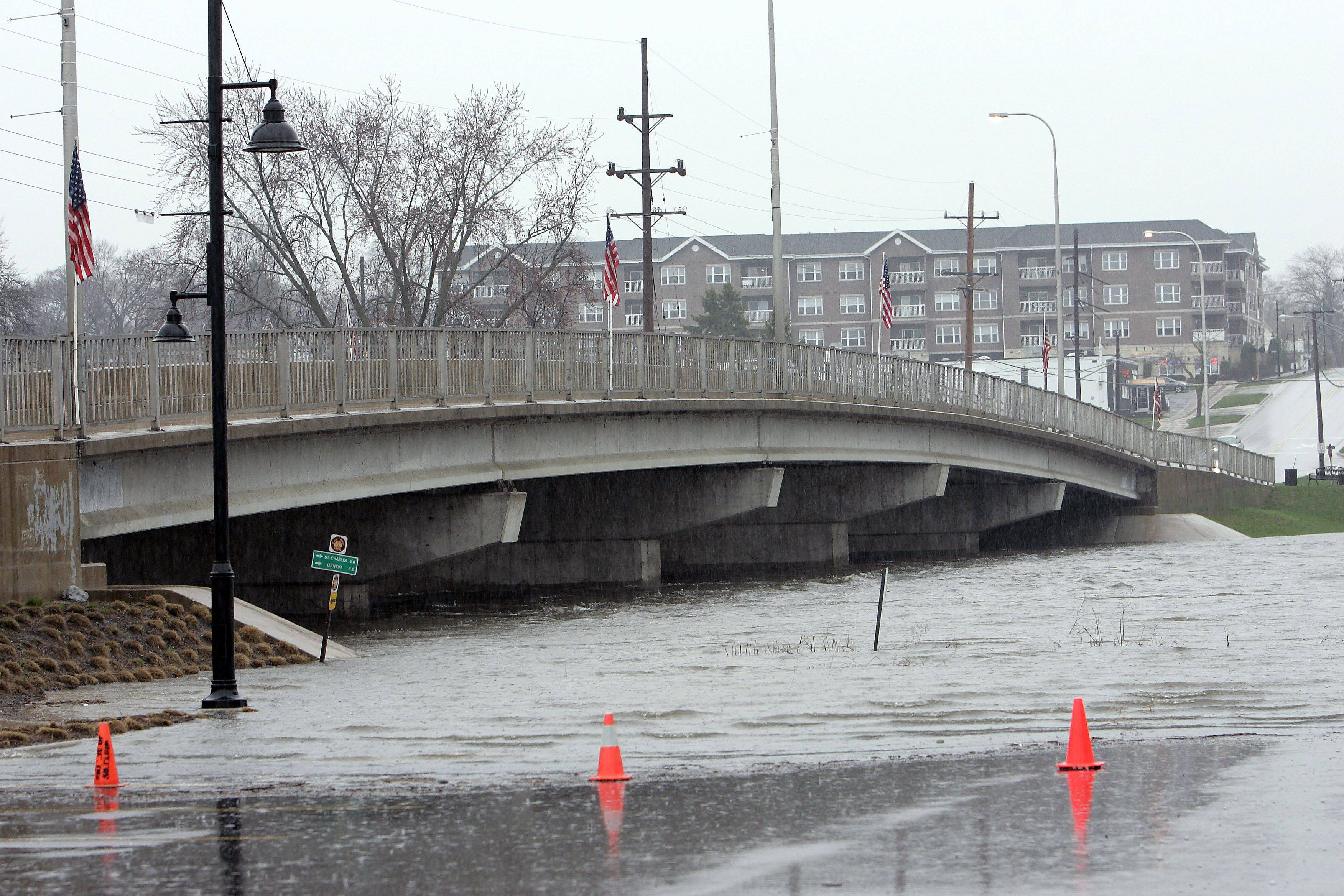 Water continues to rise on the Fox River at the bridge in South Elgin.