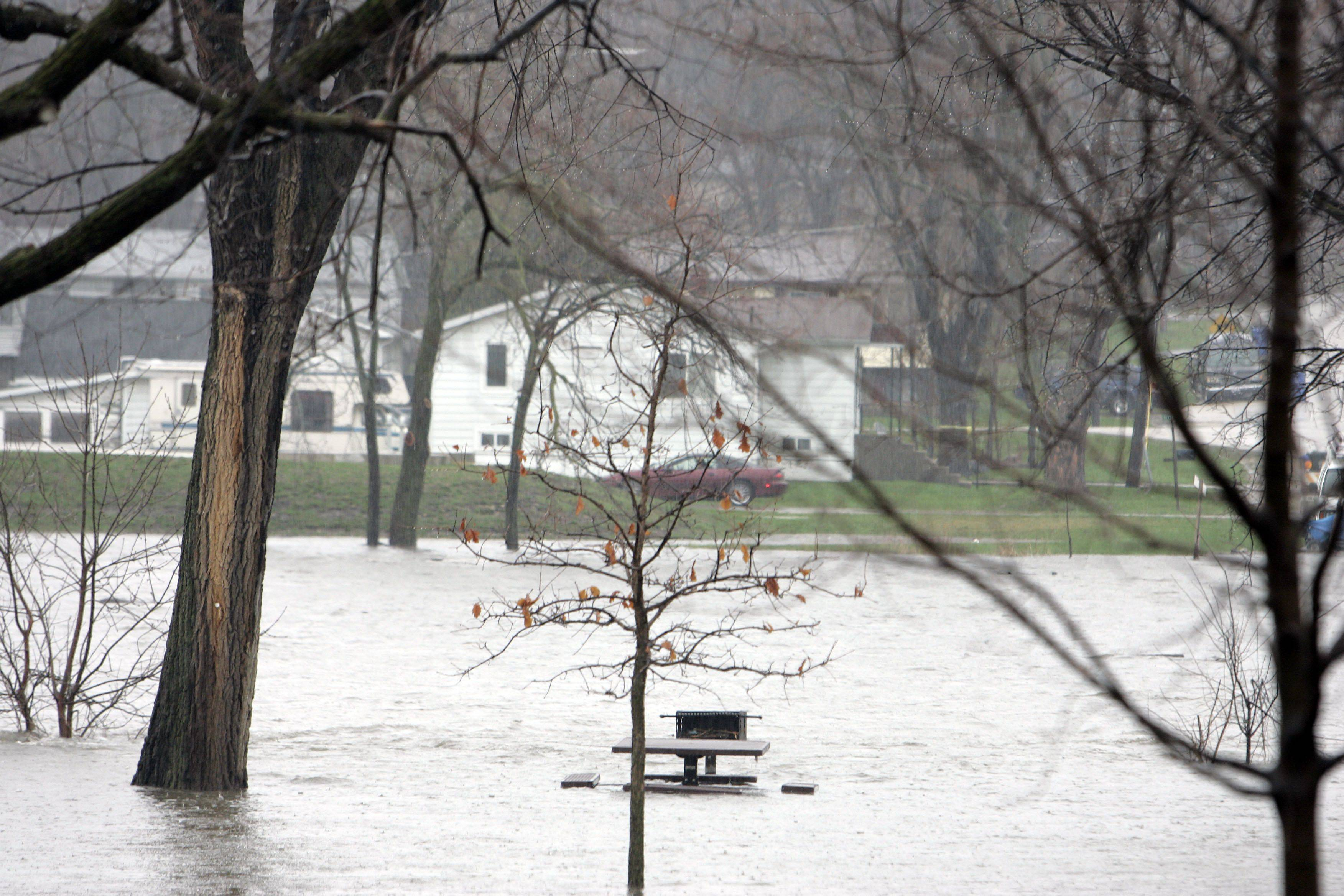 Water invades Seba Park after flooding on the Fox River Thursday in South Elgin.