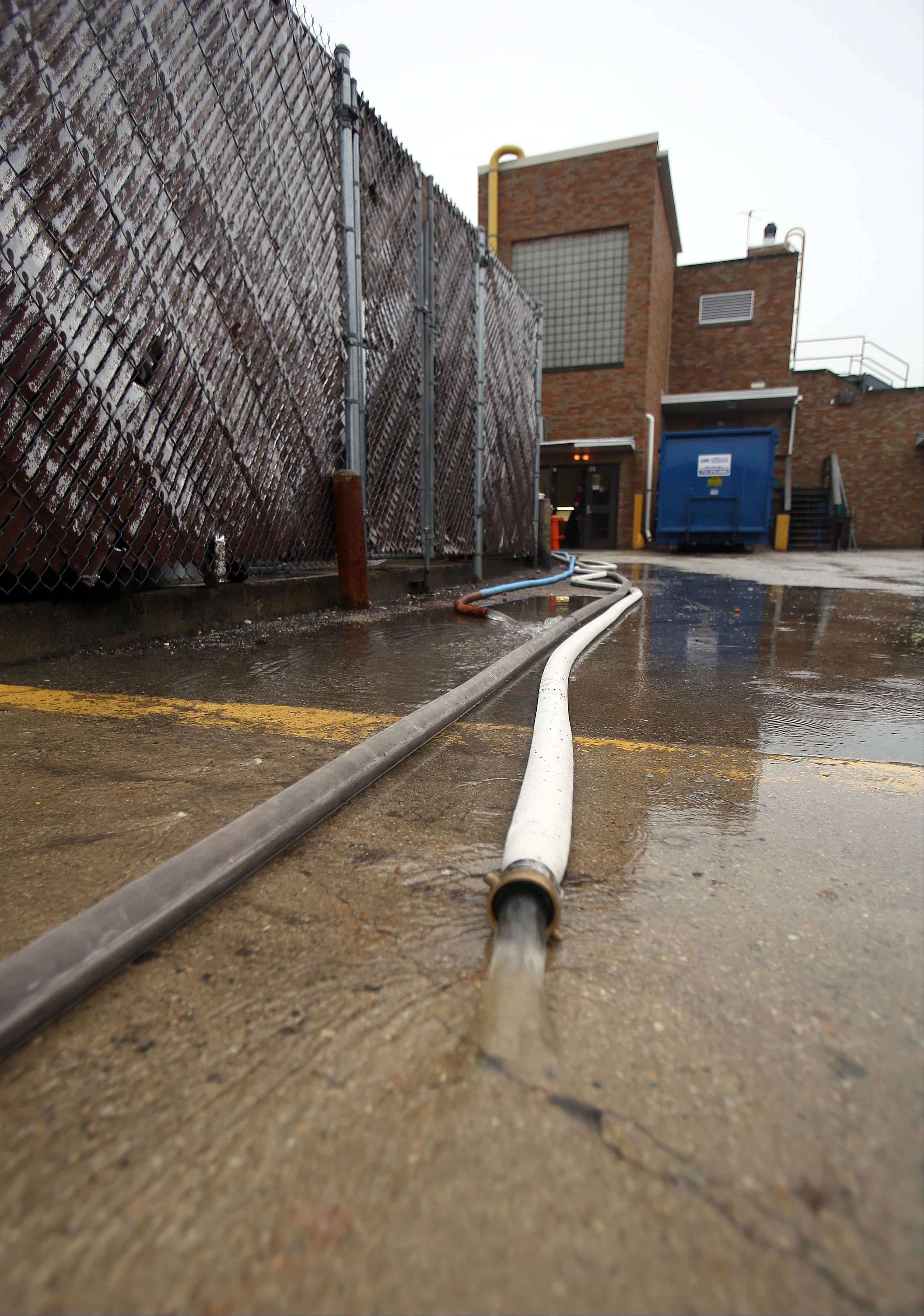 Water is pumped out from a flooded section of the sub basement at Libertyville High School Thursday.