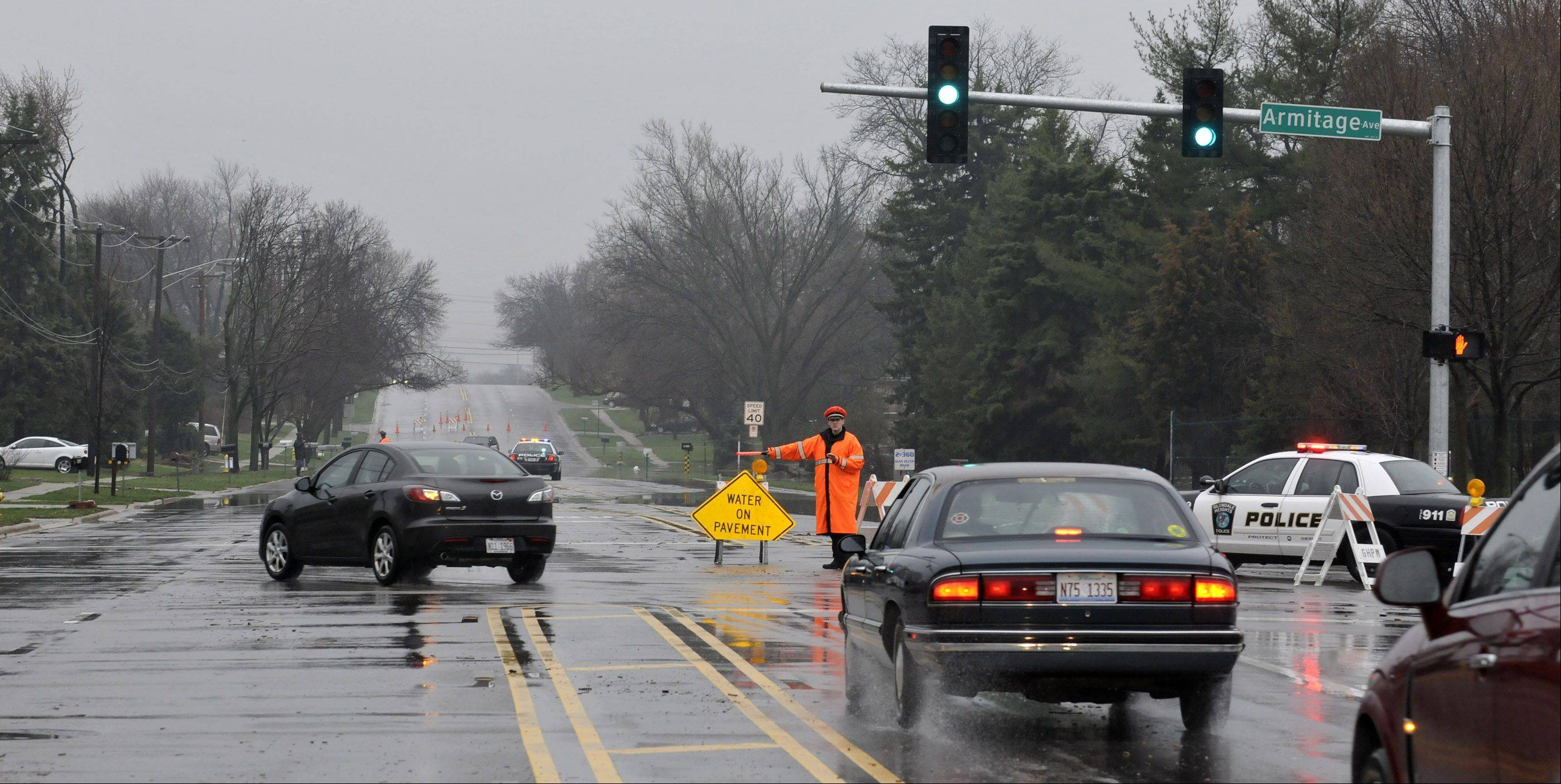 Police direct traffic off Glen Ellyn Rd. in Glendale Heights at Armitage. Heavy rains overnight resulted in heavy flooding in the DuPage County area.