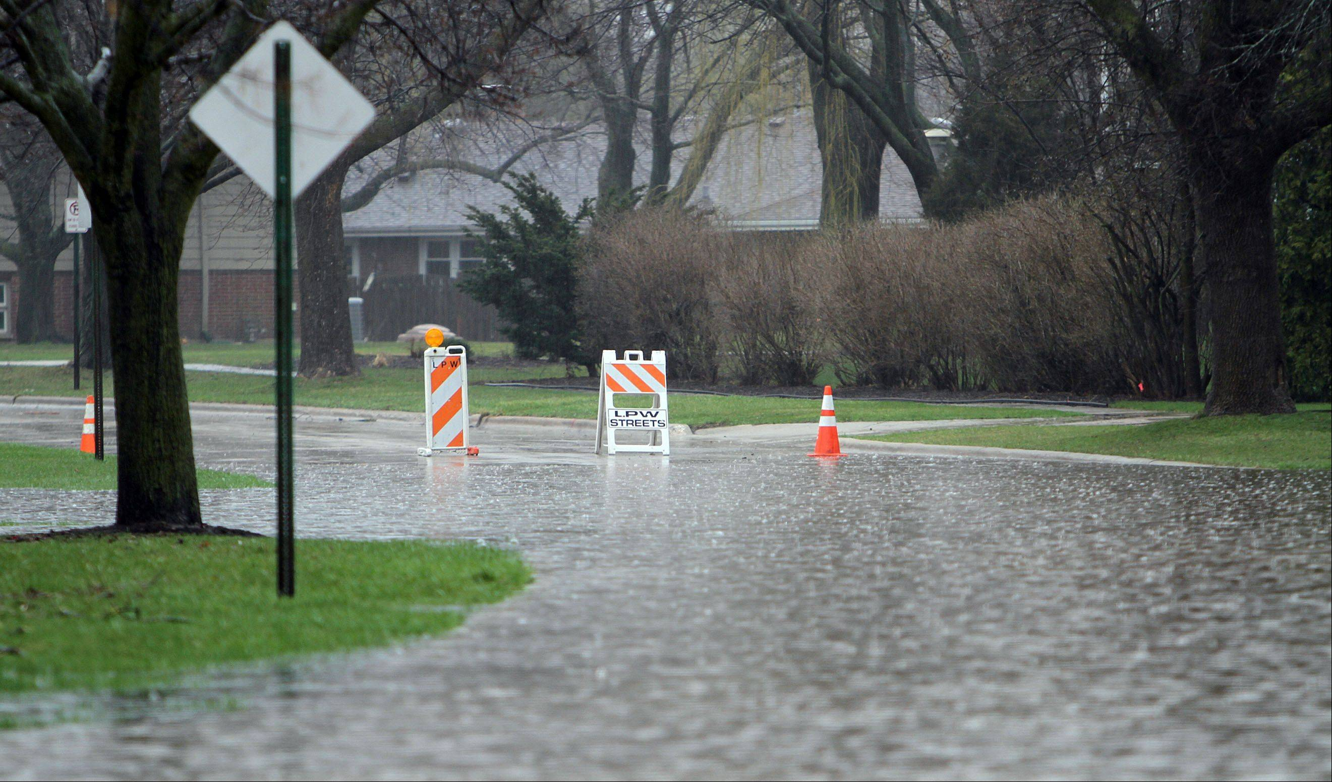 Crane St. in Libertyville was closed due to flooding Thursday morning in Libertyville.