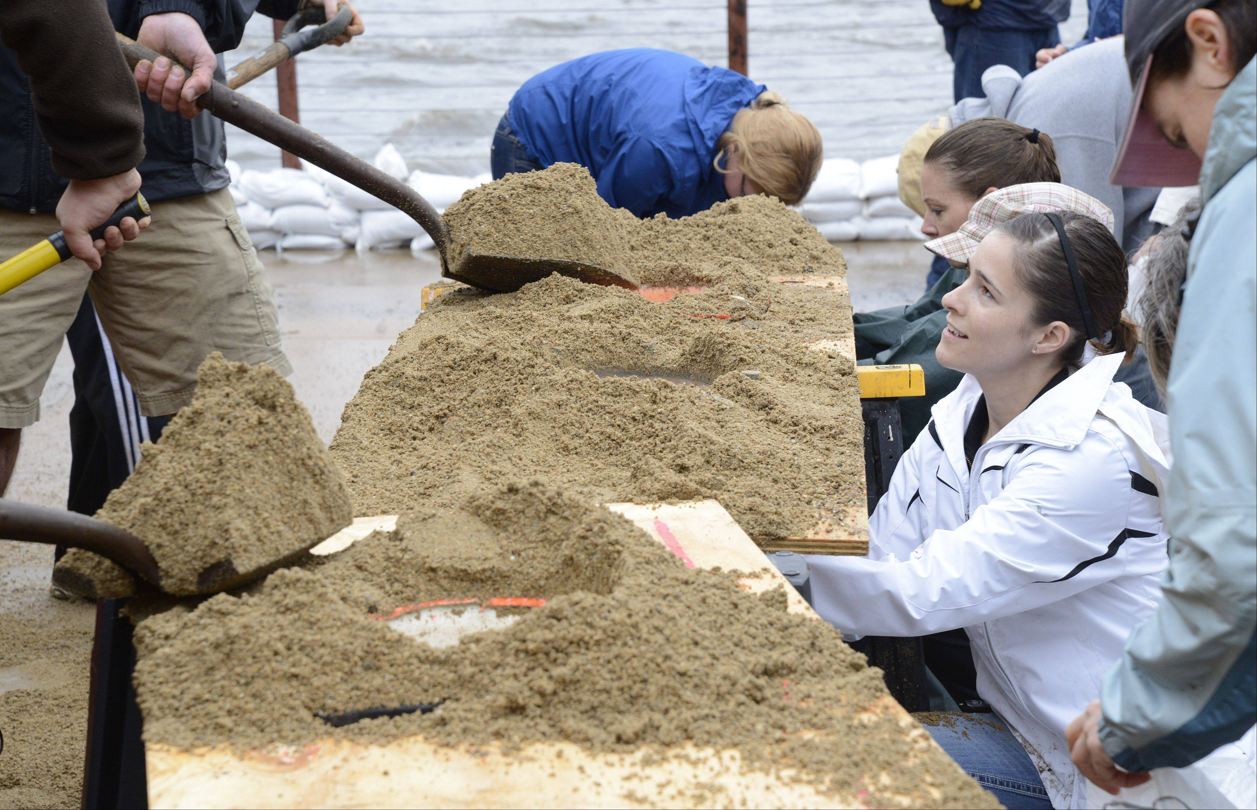 Rachel Giblin of Aurora helps sandbag at the Herrington Inn in Geneva on Thursday, April 18.