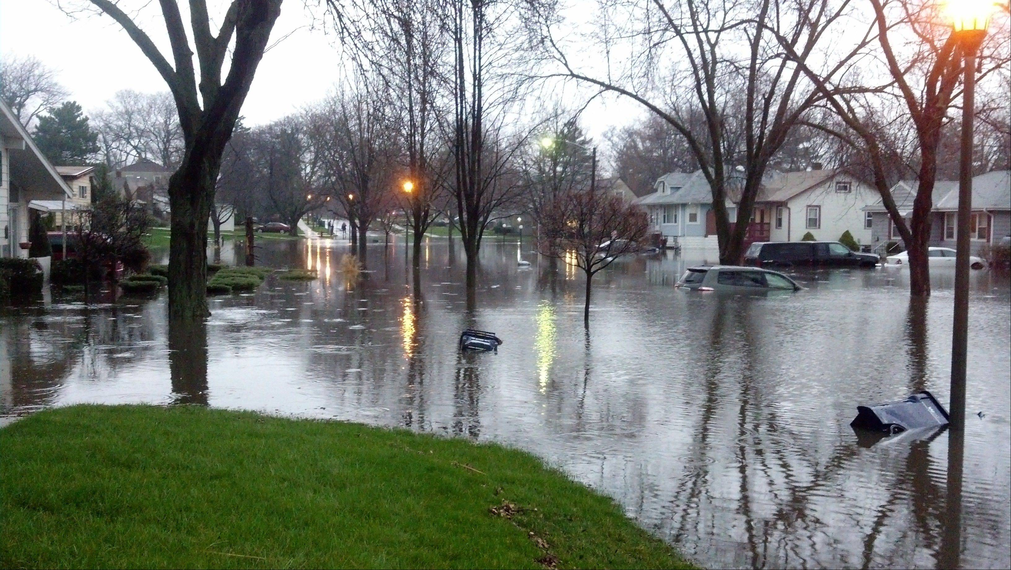 Vehicles were submerged Thursday morning at the intersection of Addison and Madison streets in Villa Park, where 9.35 inches of rain had fallen by 8:30 a.m.