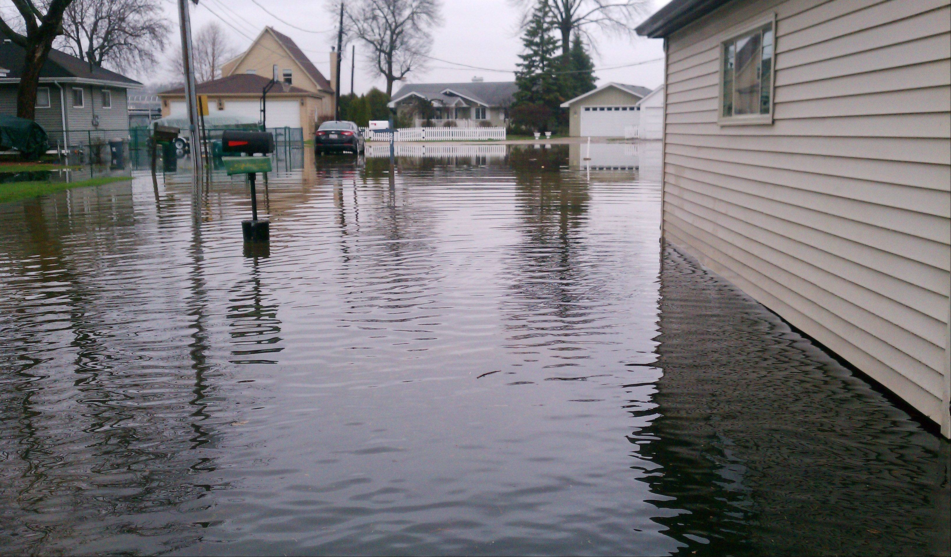 Flooding on Lakeside Lane in Fox Lake Thursday.
