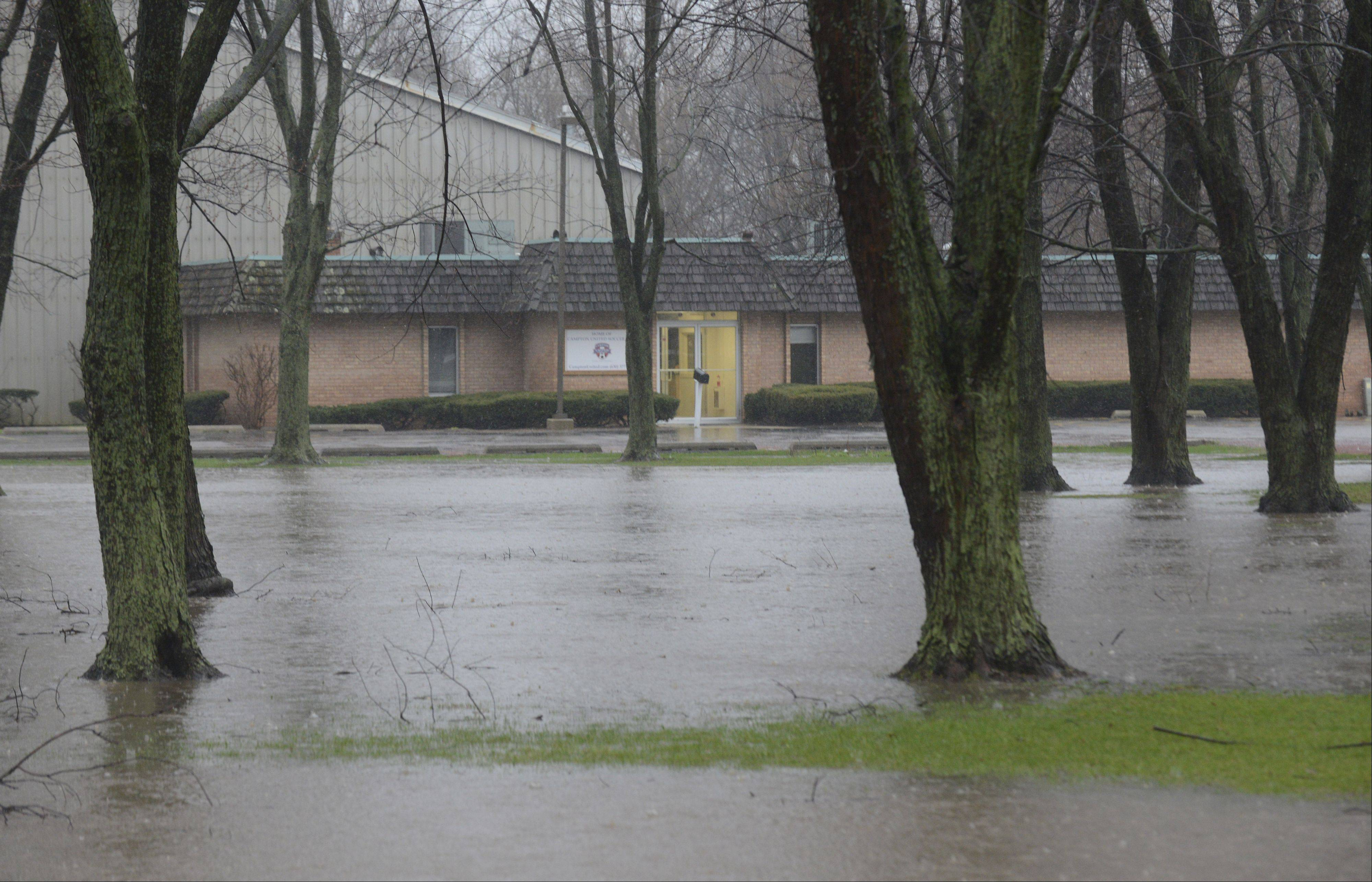 The front yard of the Campton United Soccer Club headquarters is flooded at Peck Road and Dean Street in St. Charles Thursday.