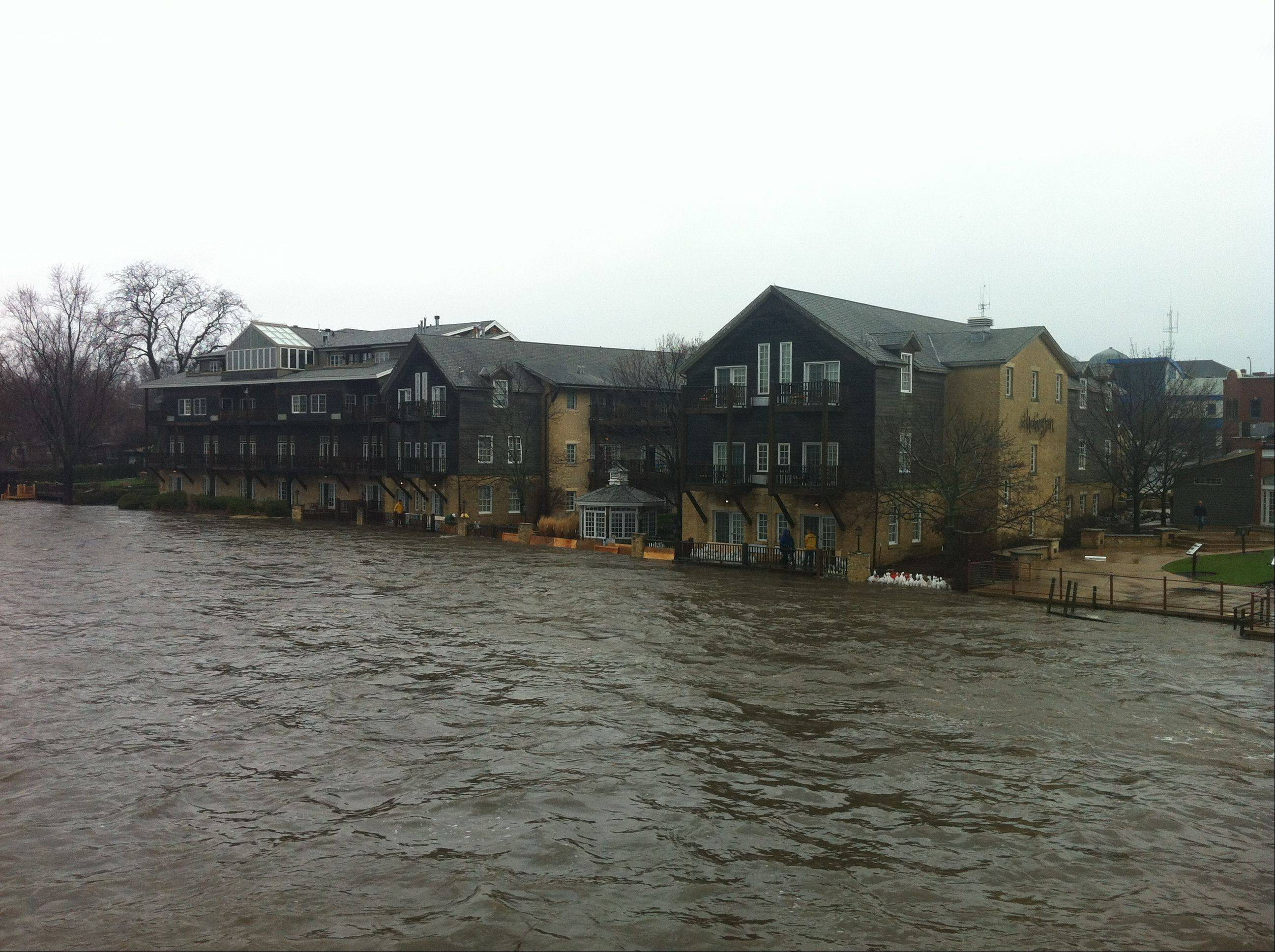 Photo courtesy of Mike NiemelaSand bags holding back the rising Fox River at the Harrington Inn in Geneva.