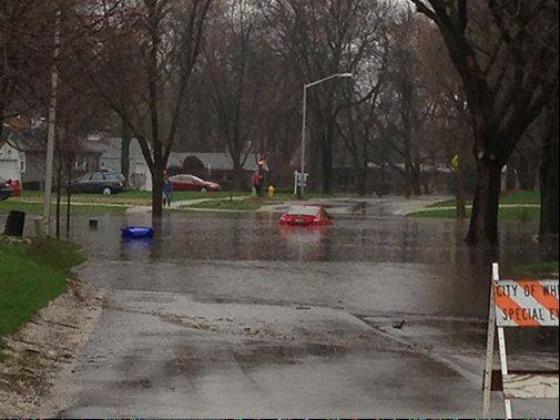 Flooding at Elm and Main Streets in Wheaton.