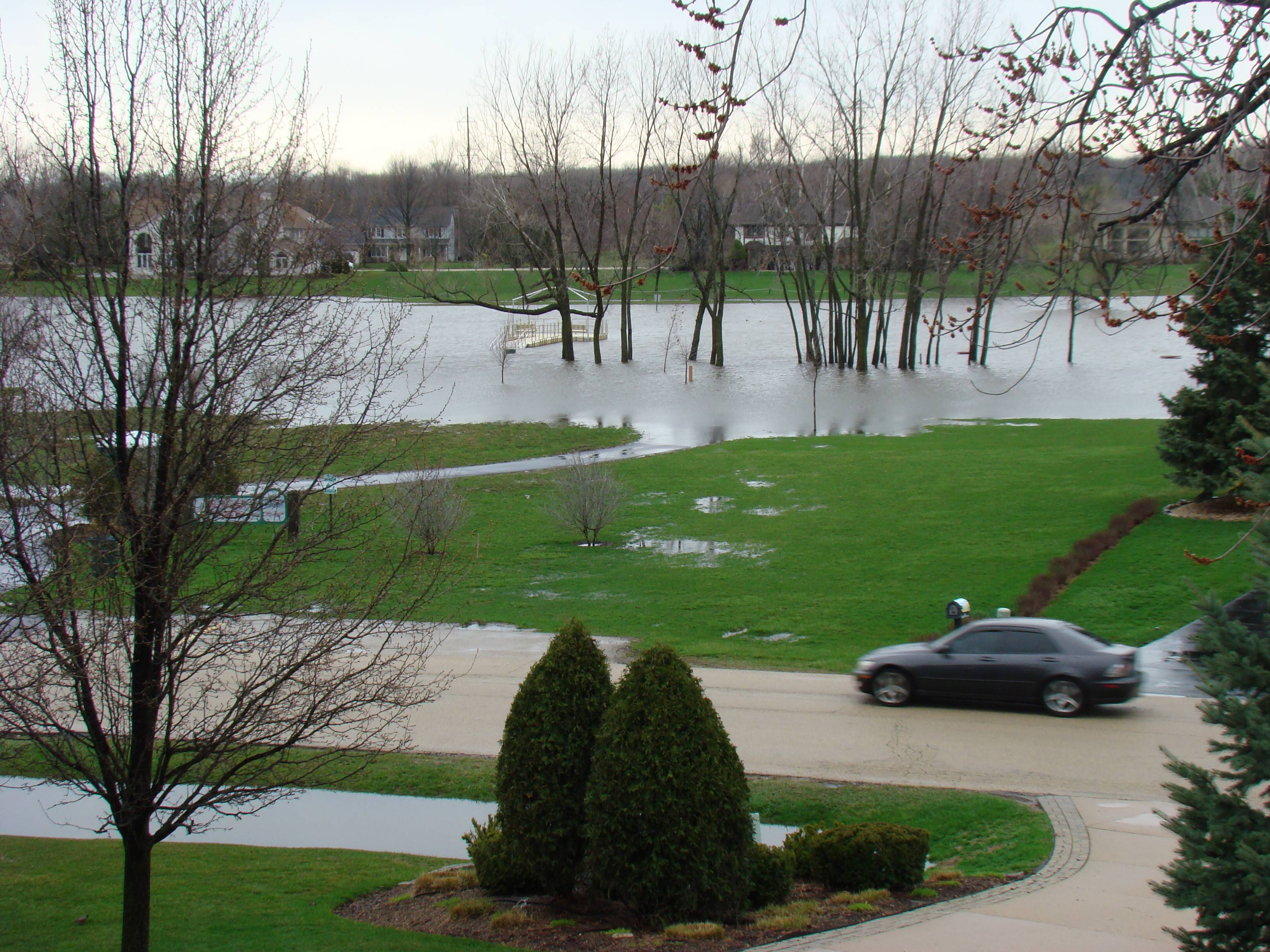 The DuPage River overflows its banks and spills into Centennial Beach in Naperville.