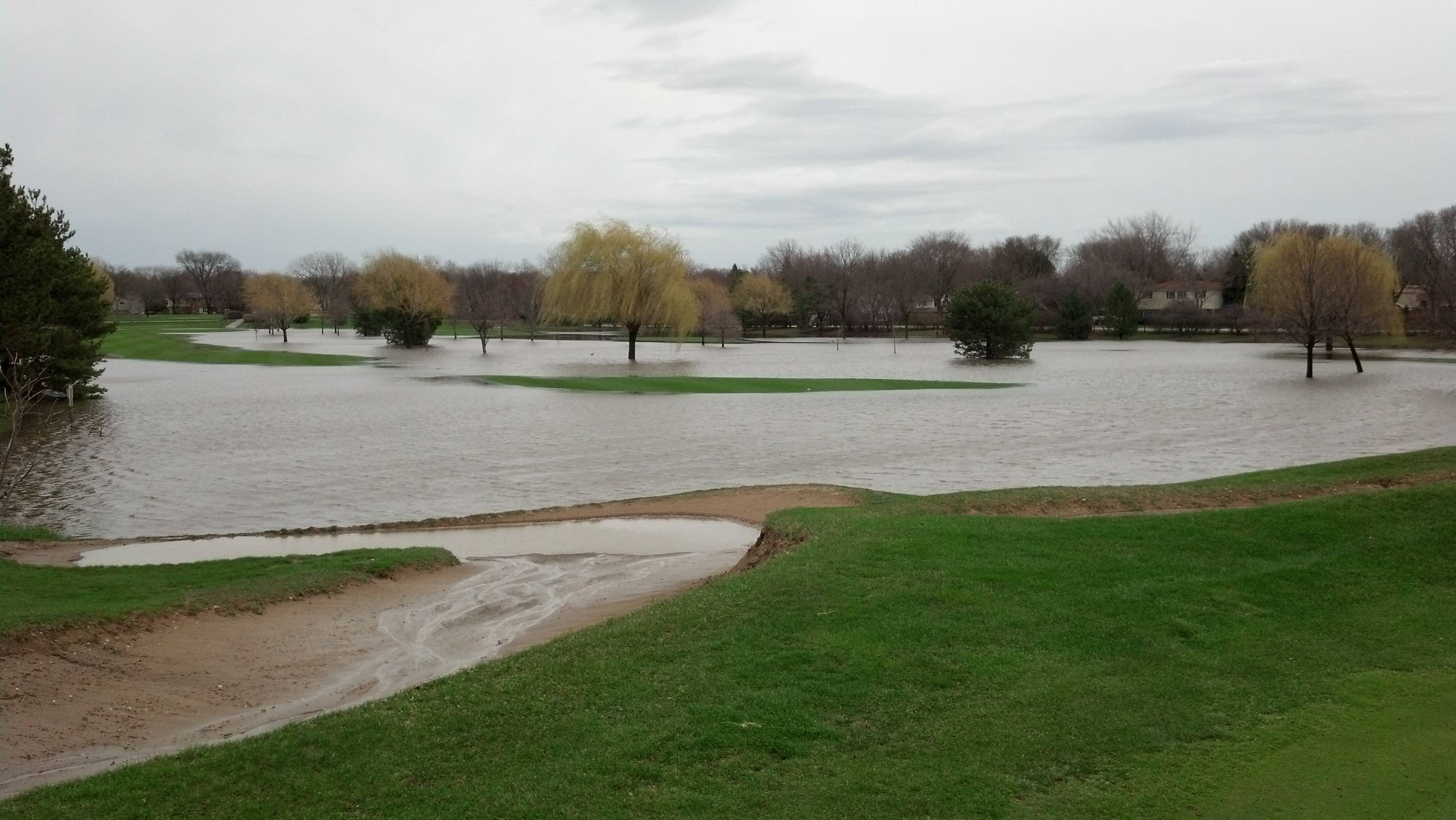 """ I am standing on the 9th hole green at Arlington Lakes GC in Arlington heights over looking the 9th and 11th fairways now being adjoined as true water holes! There is almost no where to hit your ball."