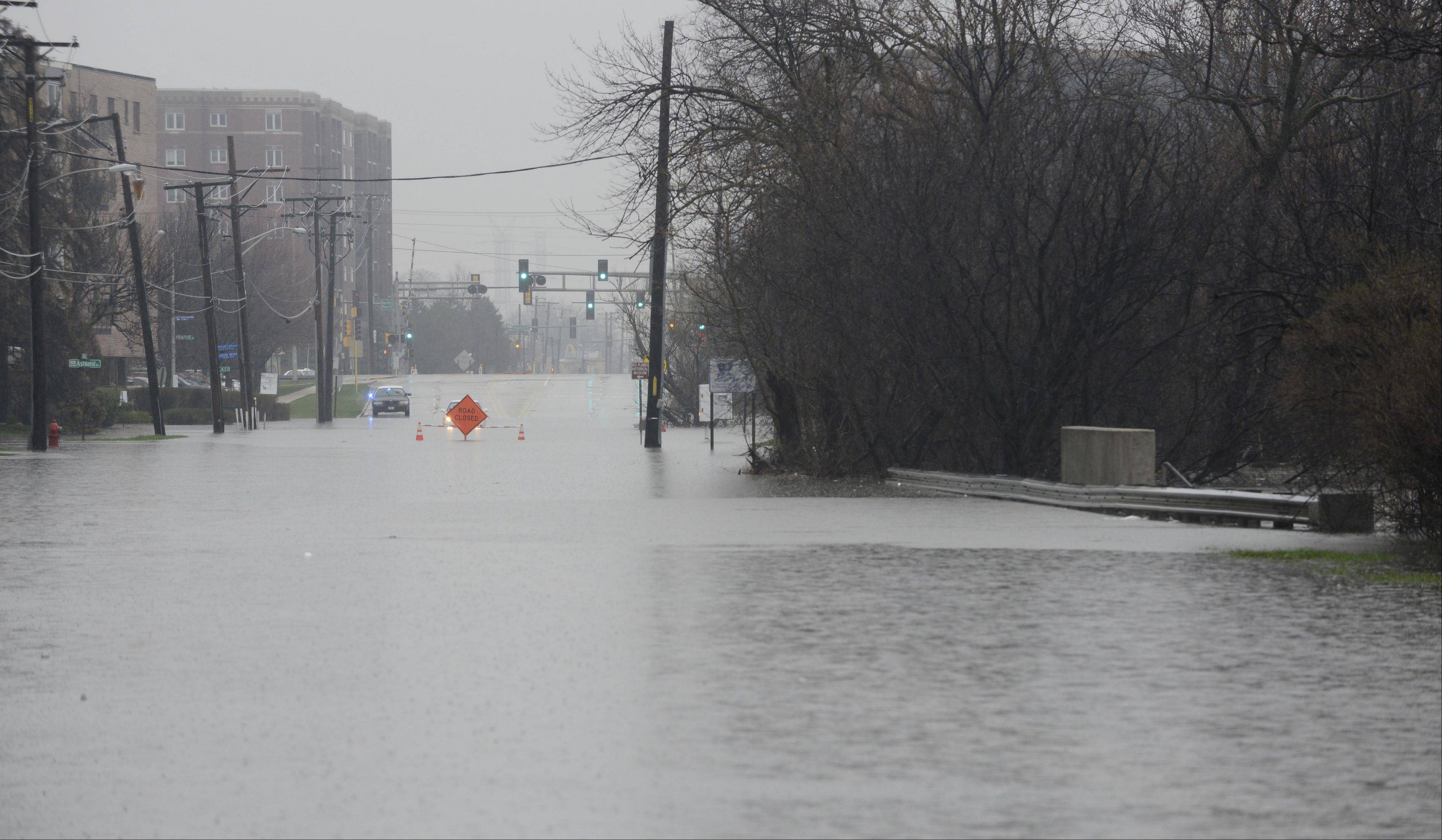 Des Plaines River Road is closed south of downtown due to flooding Thursday.