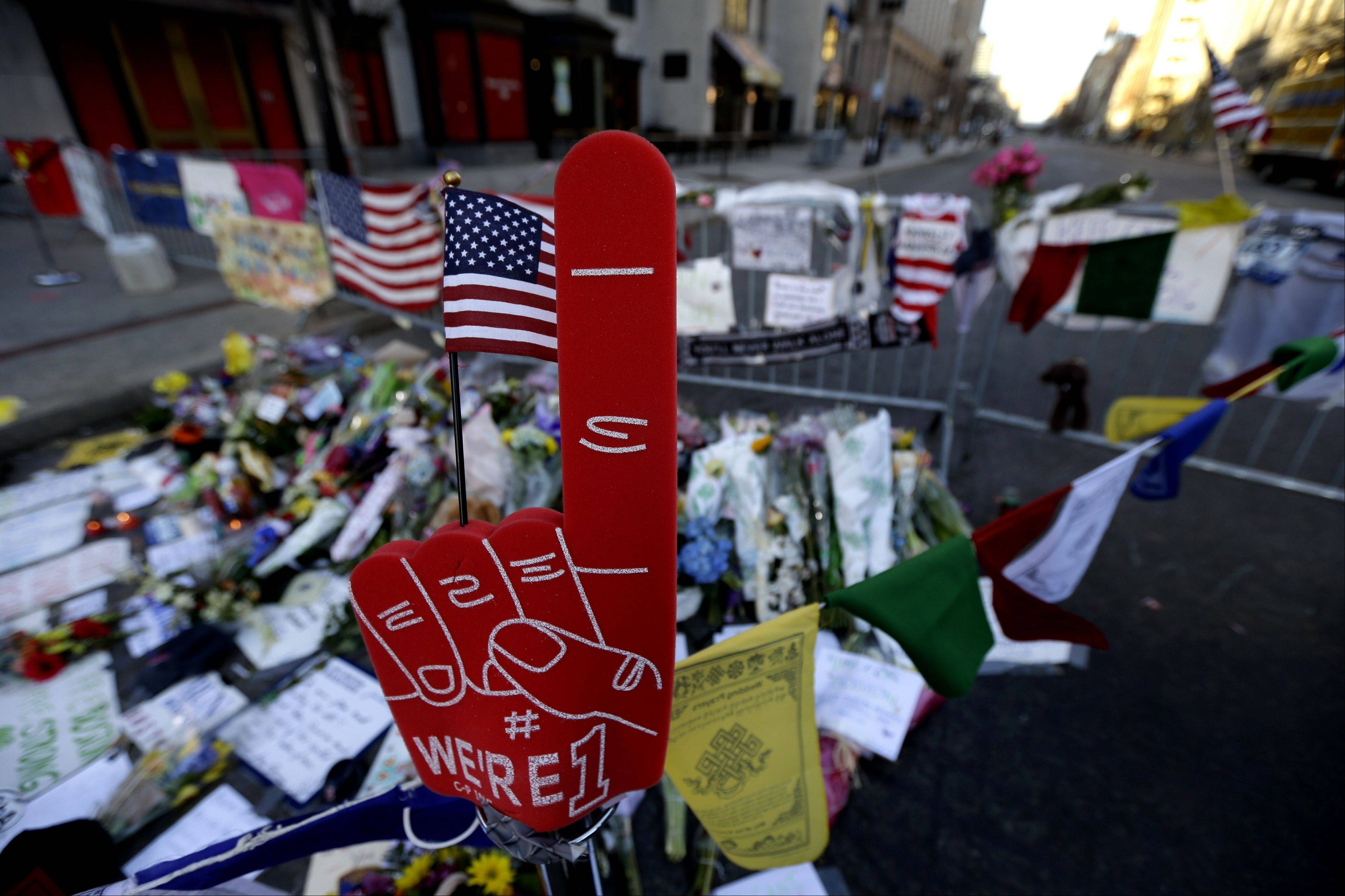 A foam finger stands at a makeshift memorial on Boylston Street in Boston, near the blast site of the Boston Marathon explosions, Thursday, April 18, 2013. The city continues to cope following Monday's explosions near the finish line of the marathon.