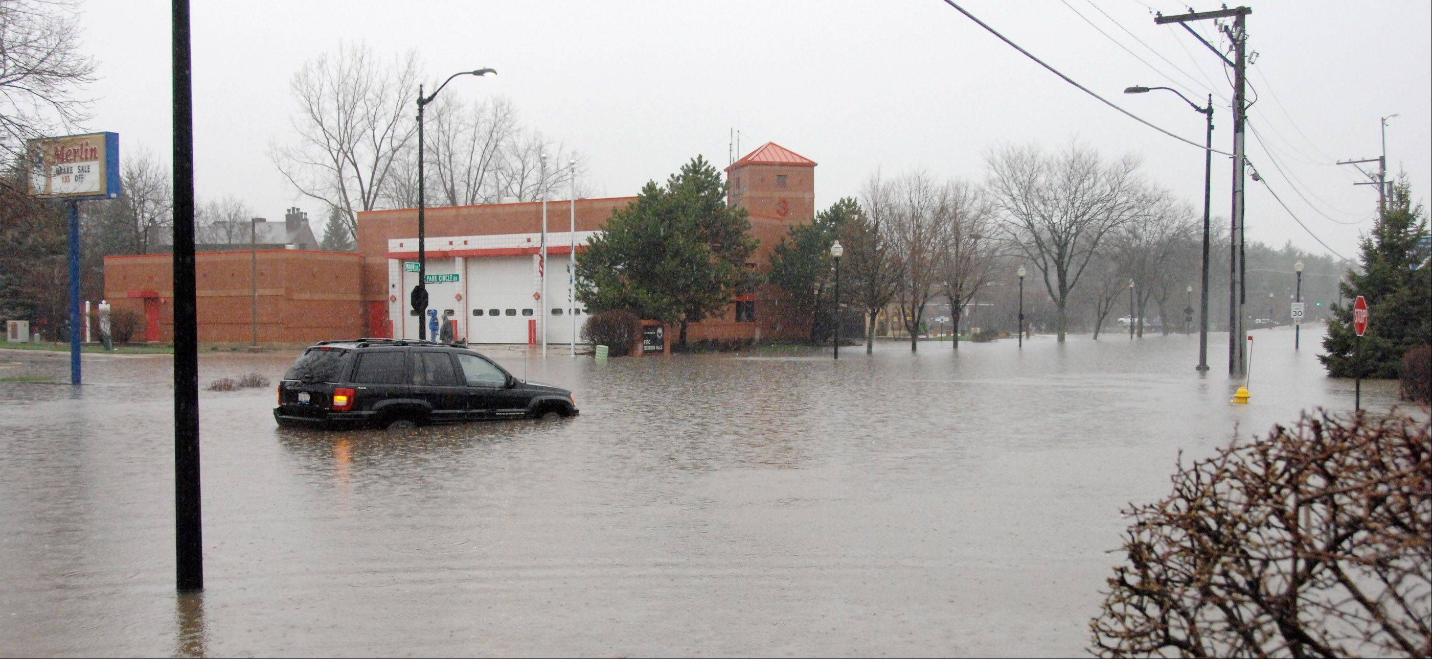 North Main Street in Wheaton is closed in front of the main fire station. Heavy rains overnight resulted in heavy flooding in the DuPage County area.