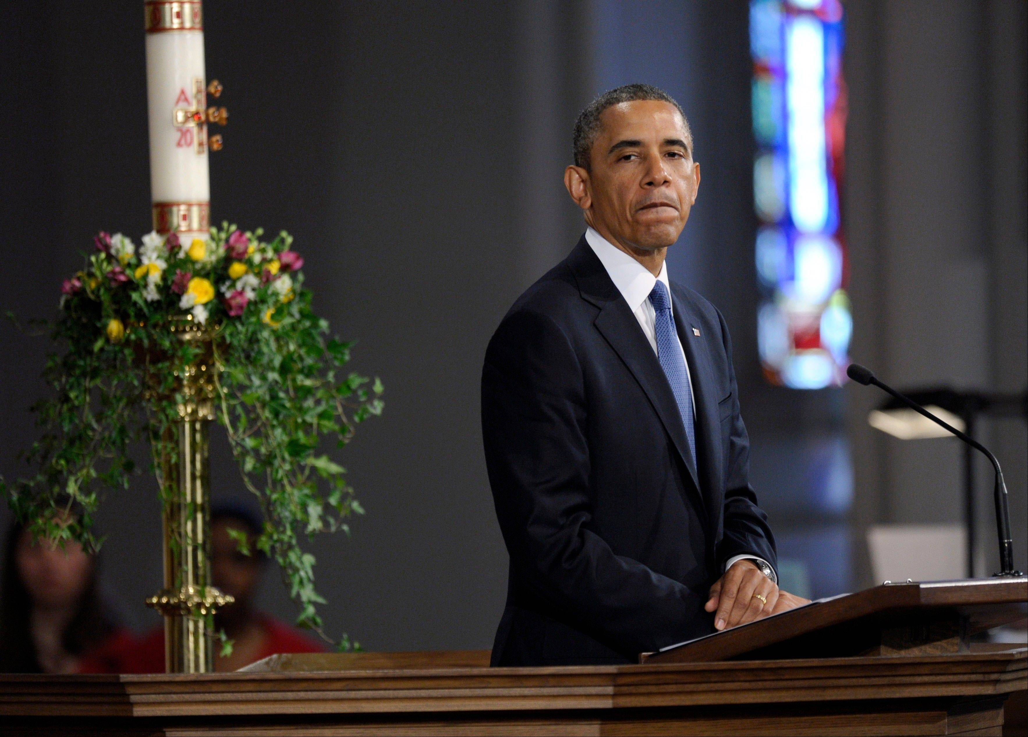 "President Barack Obama pauses while speaking at the ""Healing Our City: An Interfaith Service"" at the Cathedral of the Holy Cross in Boston, Thursday, April 18, 2013. The service is dedicated to those who were gravely wounded or killed in Monday's bombing near the finish line of the Boston Marathon."