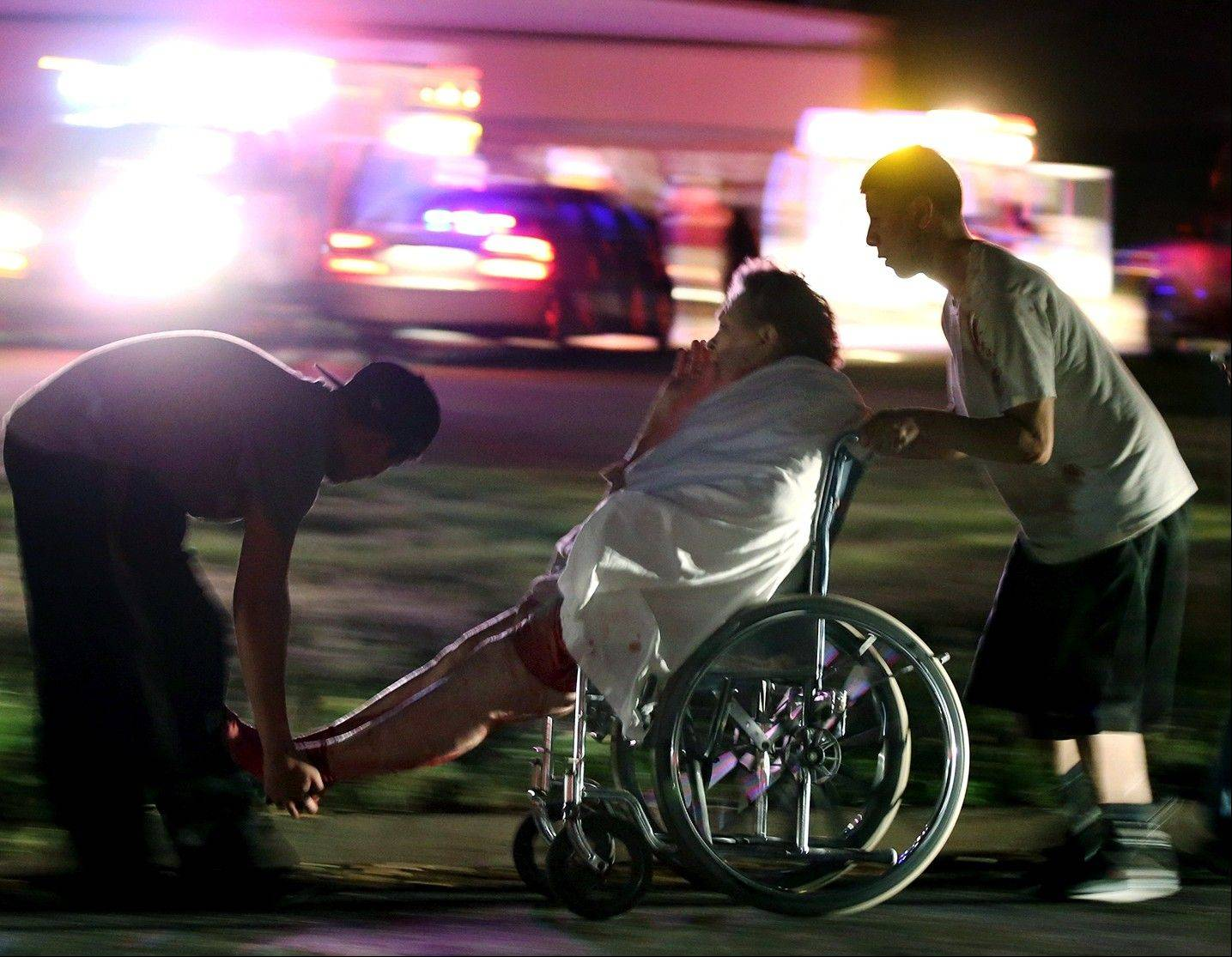An injured elderly person is assisted as a nursing home is evacuated after an explosion at a nearby fertilizer plant Wednesday in West, Texas.