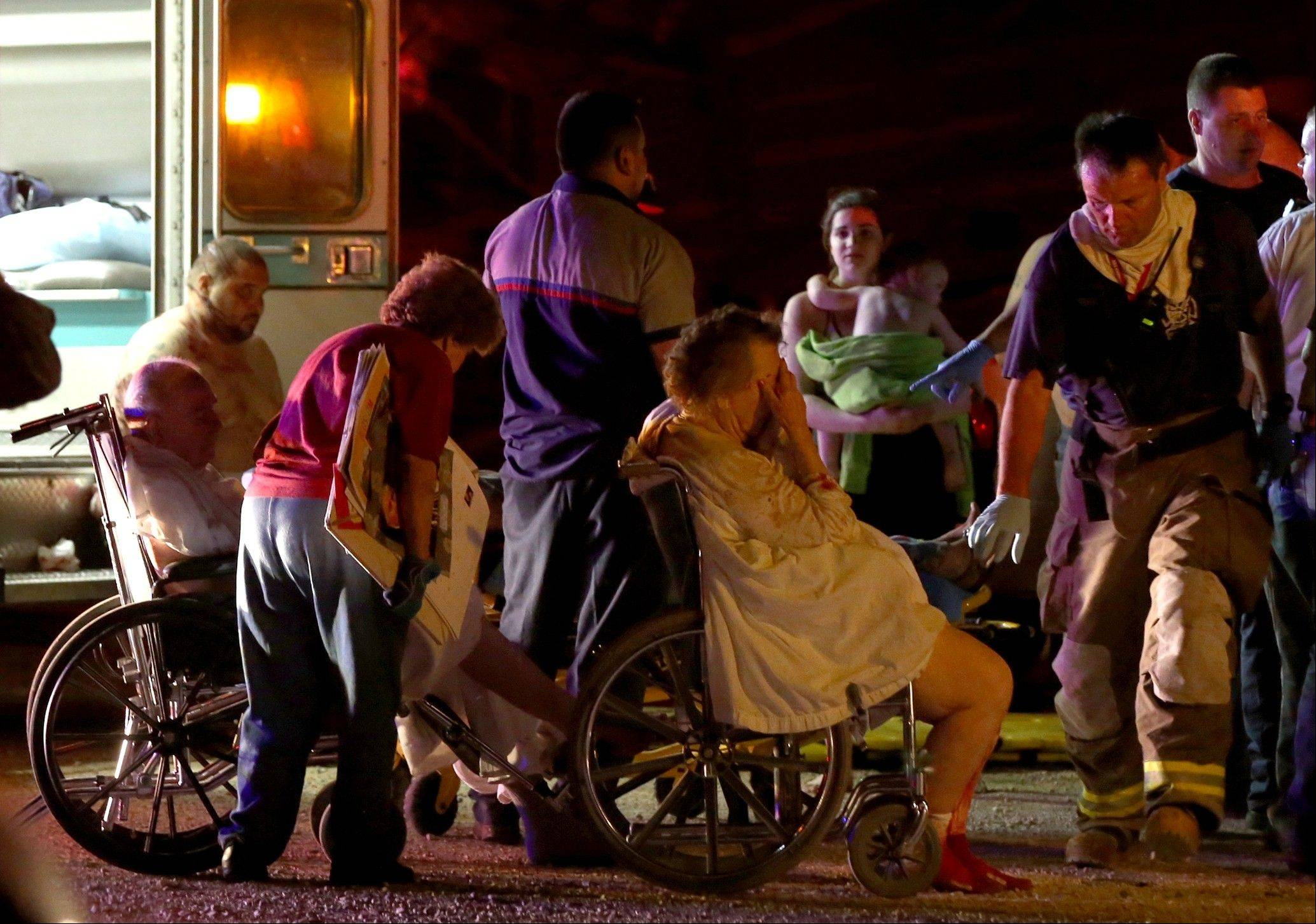 Emergency workers evacuate elderly from a damaged nursing home after the explosion in West, Texas.