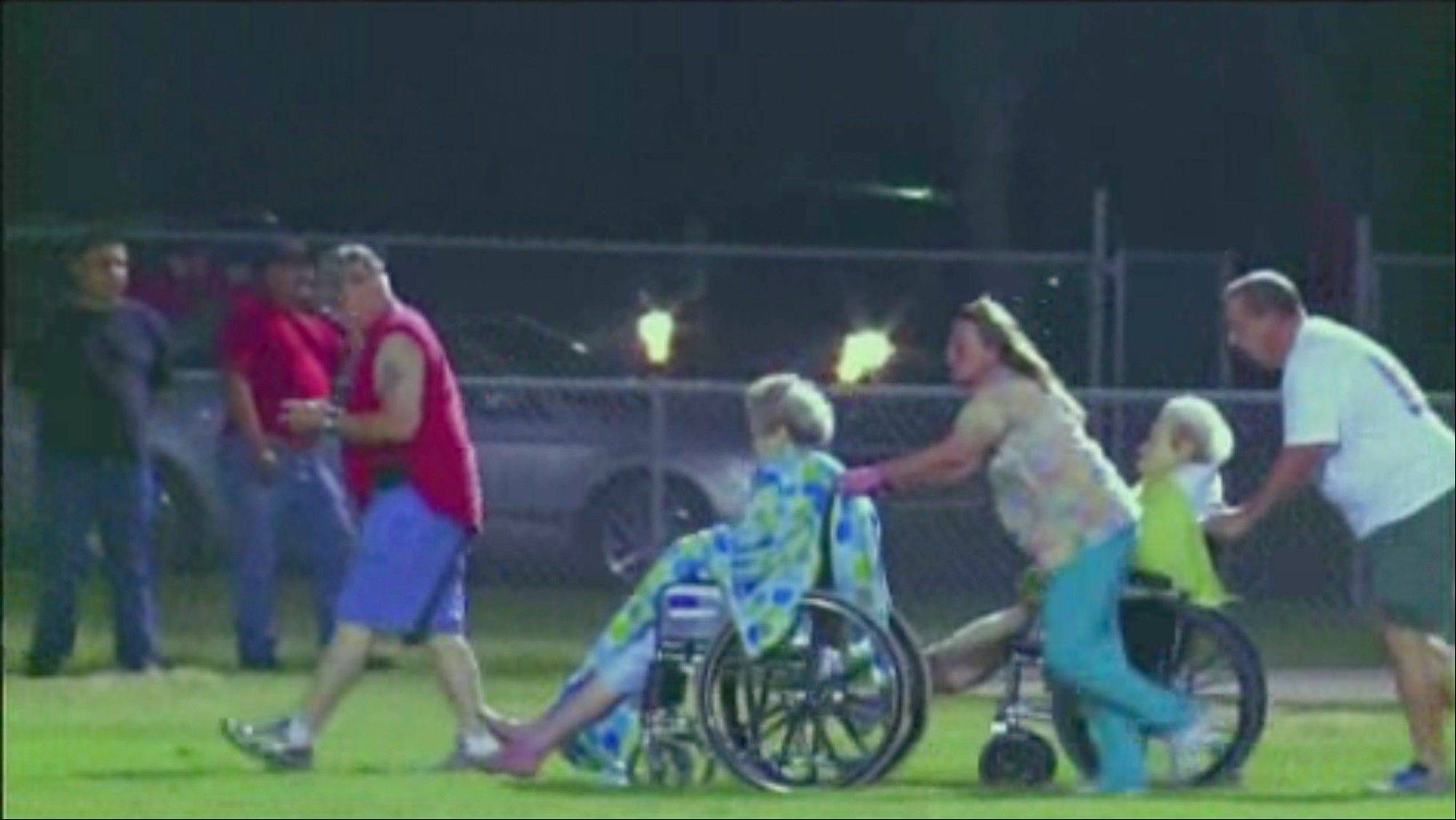This video image provided by KWTX-TV shows some of the injured from an explosion at a fertilizer plant near Waco Wednesday night being pushed across the high school football field to waiting ambulances in West Texas. The blast injured dozens of people and sent flames shooting high into the night sky, leaving the factory a smoldering ruin and causing major damage to surrounding buildings.