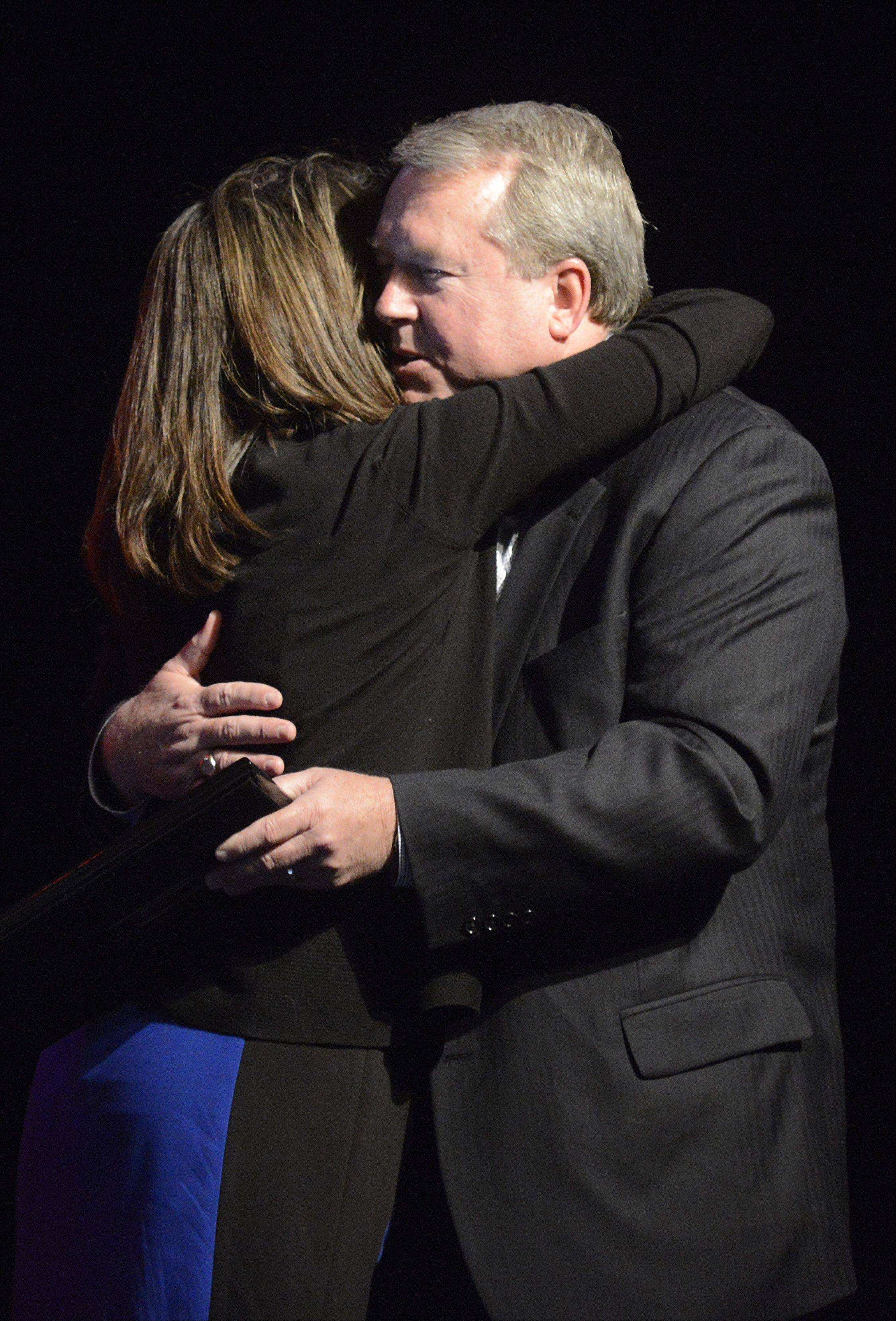 Laura Stoecker/lstoecker@dailyherald.comSt. Charles Mayor Don DeWitte hugs his wife, Diane, after her speech to him at his farewell party hosted Wednesday at the Arcada Theatre.