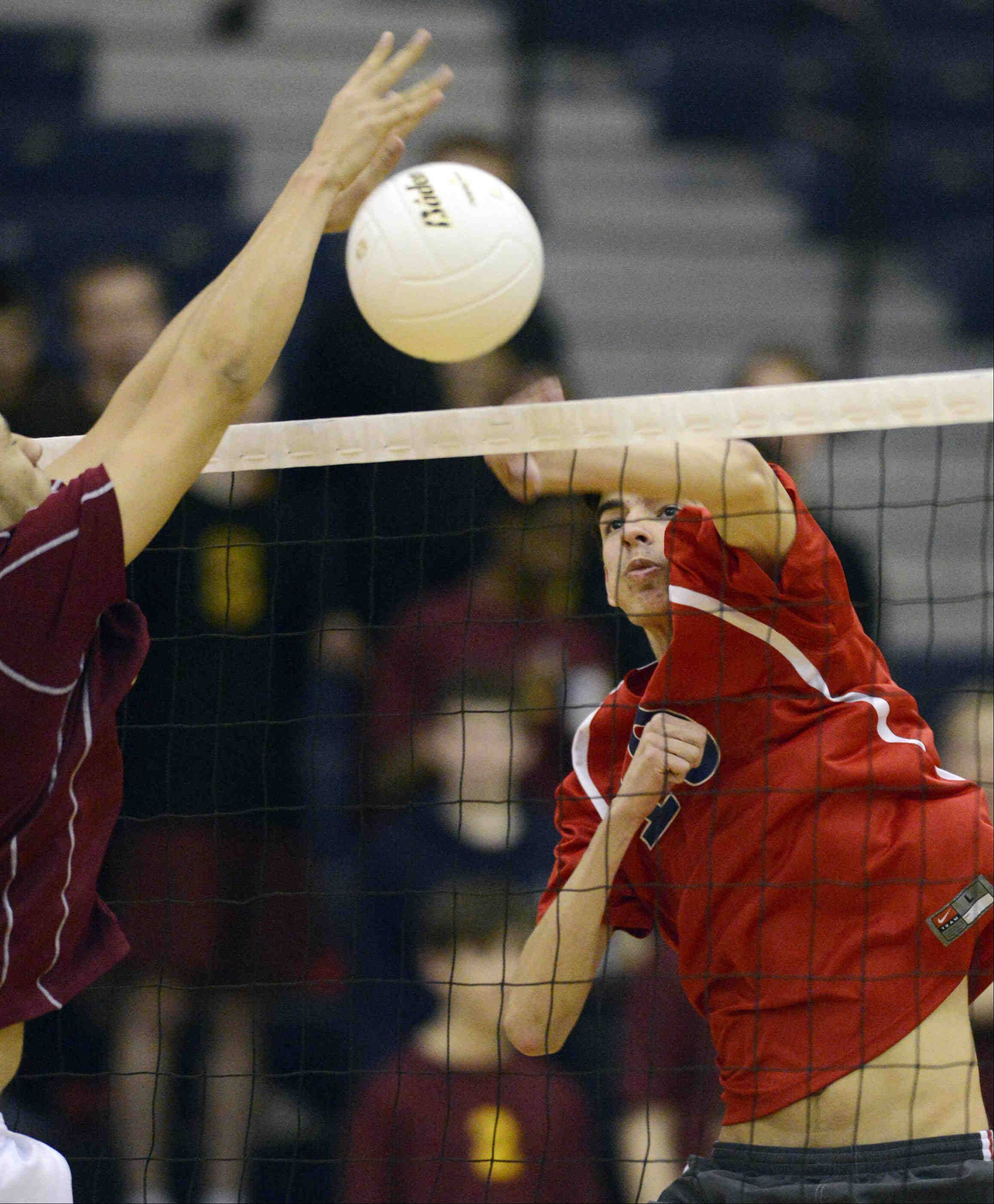 South Elgin's Chis Gibadlo hits the ball around Schaumburg's Romario Rios Thursday in South Elgin.