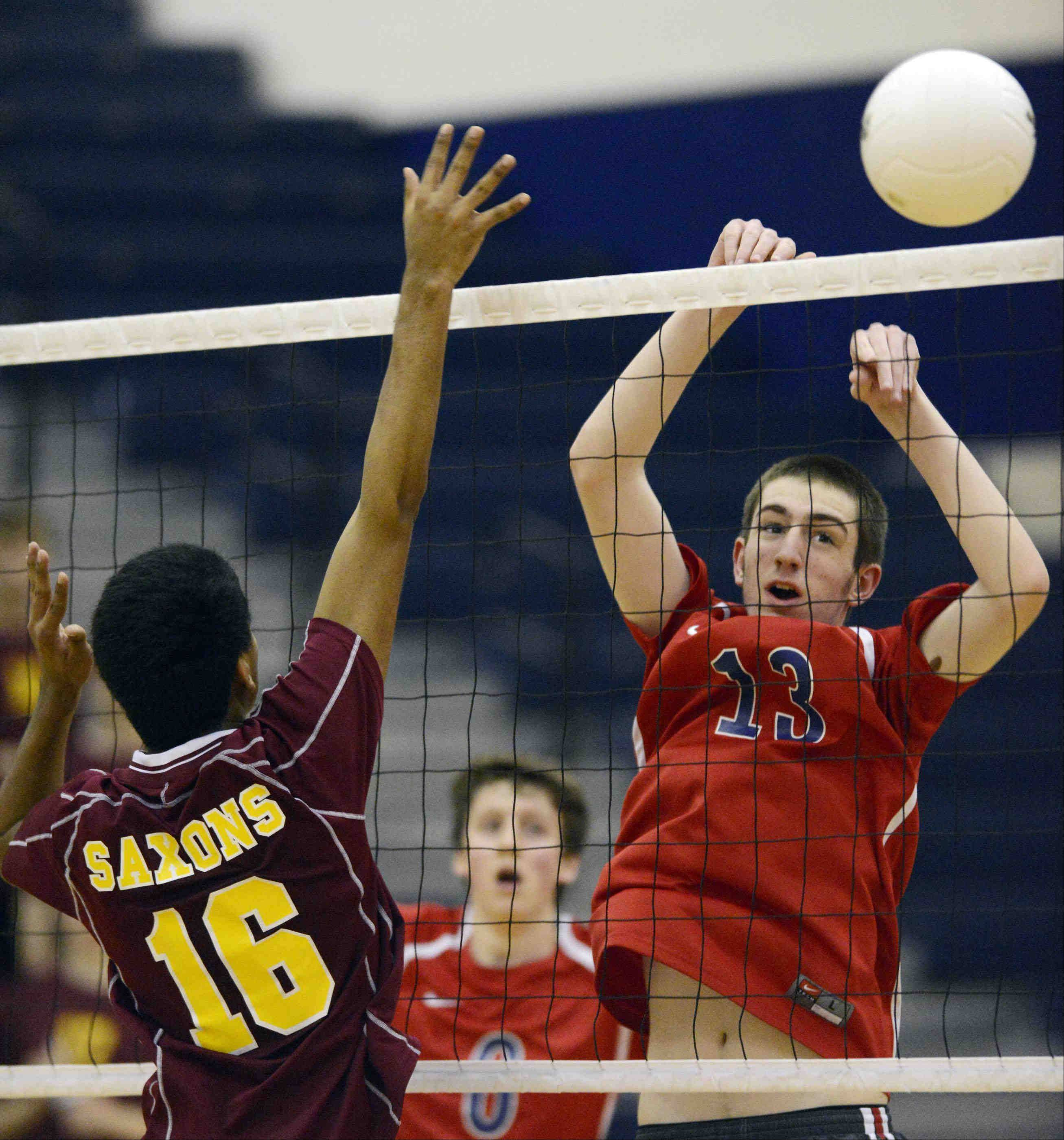 South Elgin's Ian Saxton hits the ball past Schaumburg's Nidhin Thomas Thursday in South Elgin.
