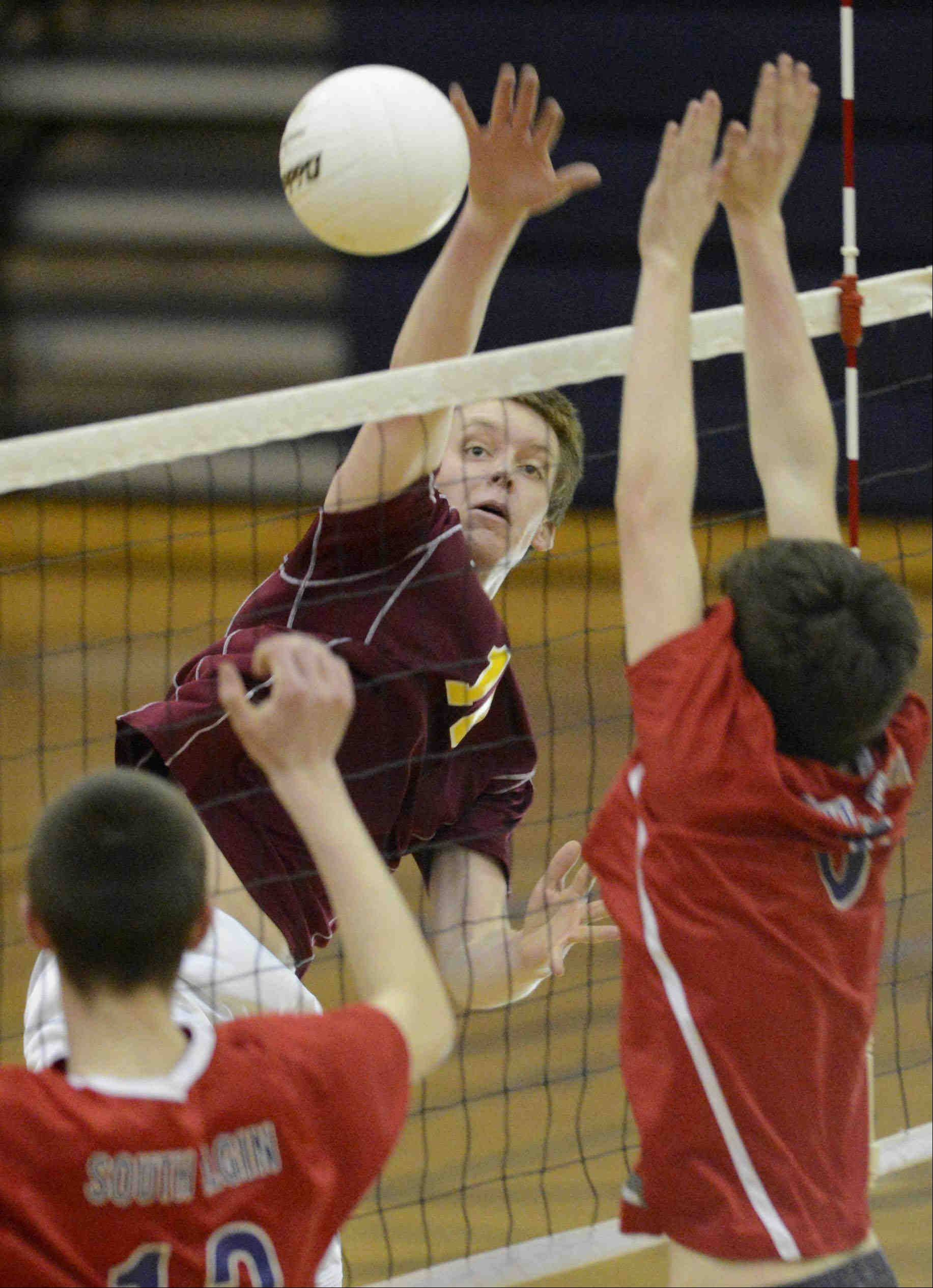 Schaumburg's Stephen Knitter gets a shot past South Elgin's Ian Saxton and Jake Dinneen Thursday in South Elgin.