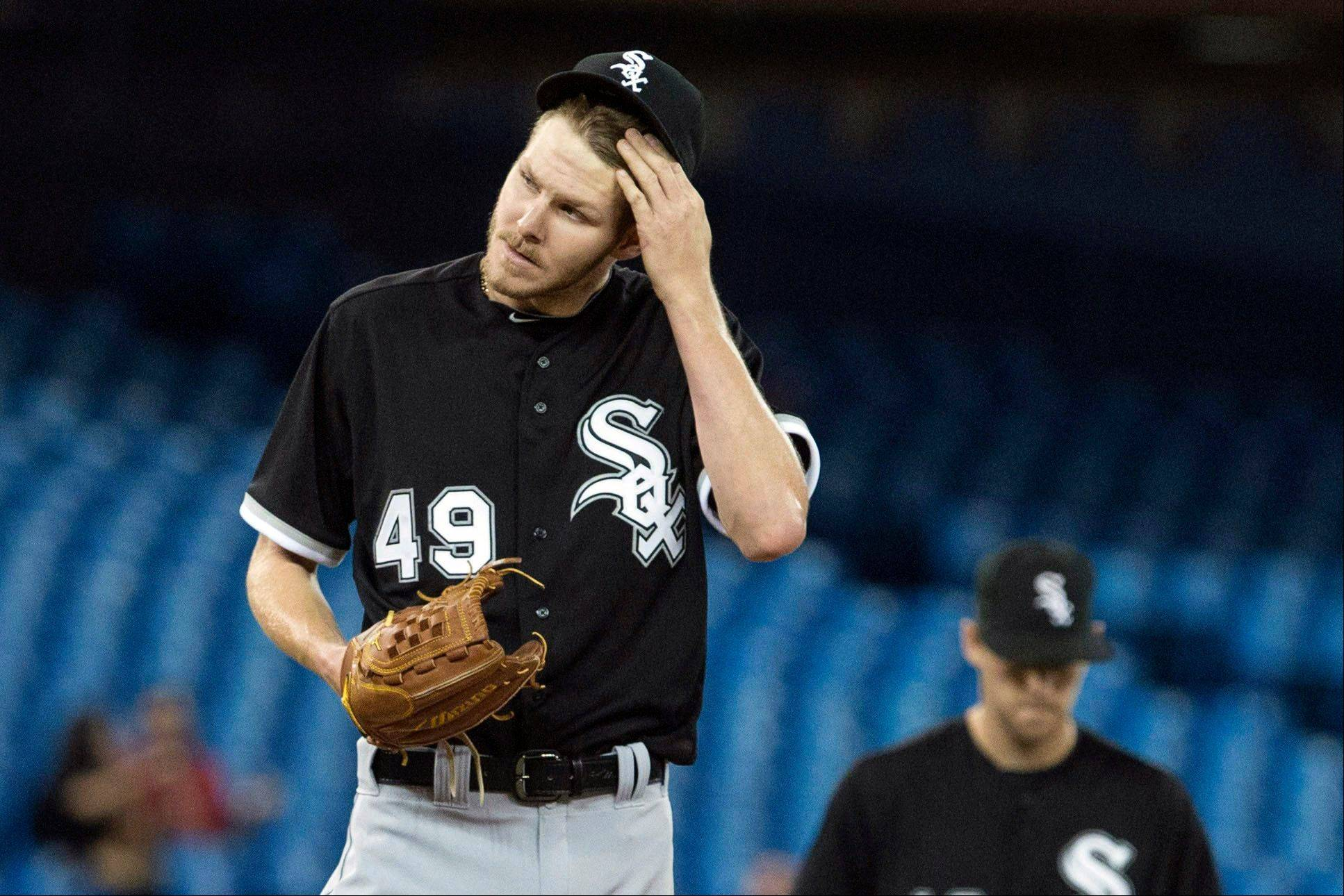 Chicago White Sox pitcher Chris Sale reacts during the fifth inning of a baseball game against the Toronto Blue Jays, Thursday, April 18, 2013, in Toronto.