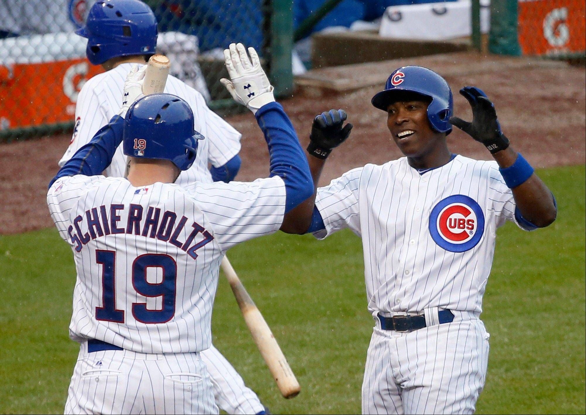 The Cubs' Alfonso Soriano, right, is greeted at home by Nate Schierholtz after Soriano's first homer of the season Thursday against the Rangers at Wrigley Field.