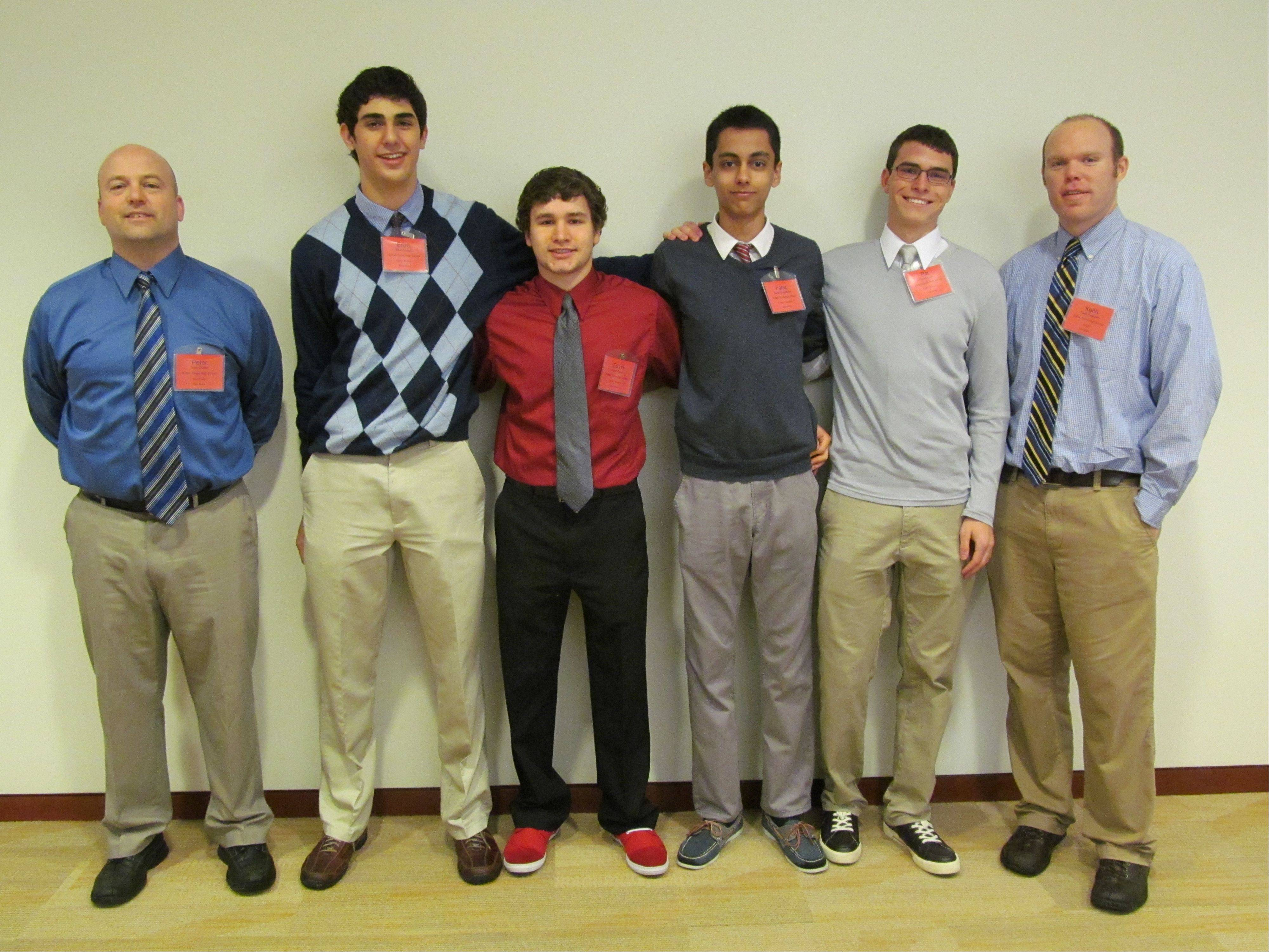 "Buffalo Grove High School's team, ""Too Big to Fail,"" at the 2013 Economics Challenge State Finals. Pictured from left, are: Coach Pete Duffer, seniors Enzo Inman, D.J. Prorok, Faraz Shahidpour and Patrick McGrath and coach Keith Peterson."