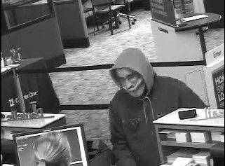 A man described to be between 55 and 60 years old robbed the Charter One Bank Friday in Rolling Meadows, authorities said.