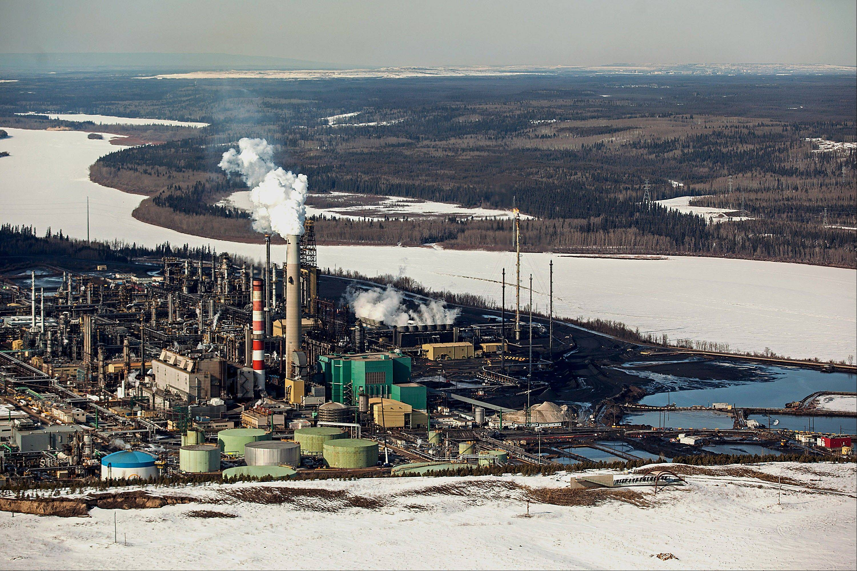 The Suncor Energy Inc. base plant is seen in this aerial photograph of the Athabasca Oil Sands near Fort McMurray, Alberta, Canada. Canadian light oil prices retreated from a six-month high on the spot market reached last week as production slipped and refineries prepared for maintenance.