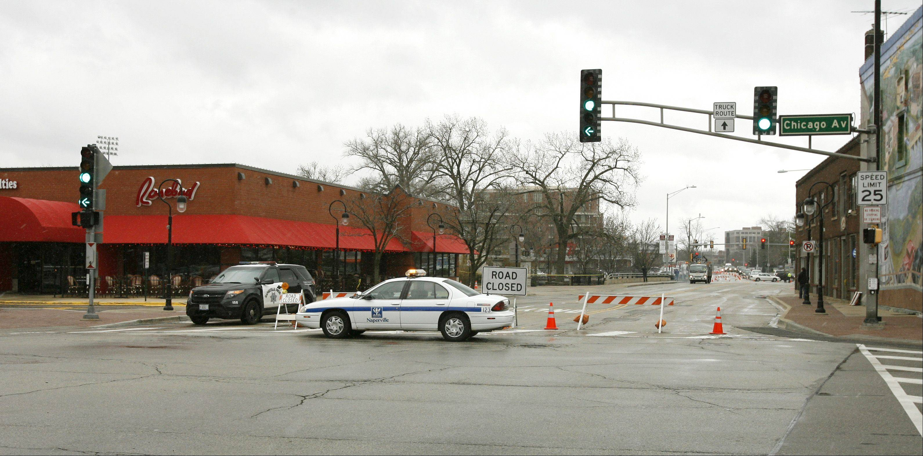 Southbound Washington Street, Naperville�s main north-south thoroughfare, remained closed until Friday afternoon because of flooding on the bridge that spans the DuPage River.