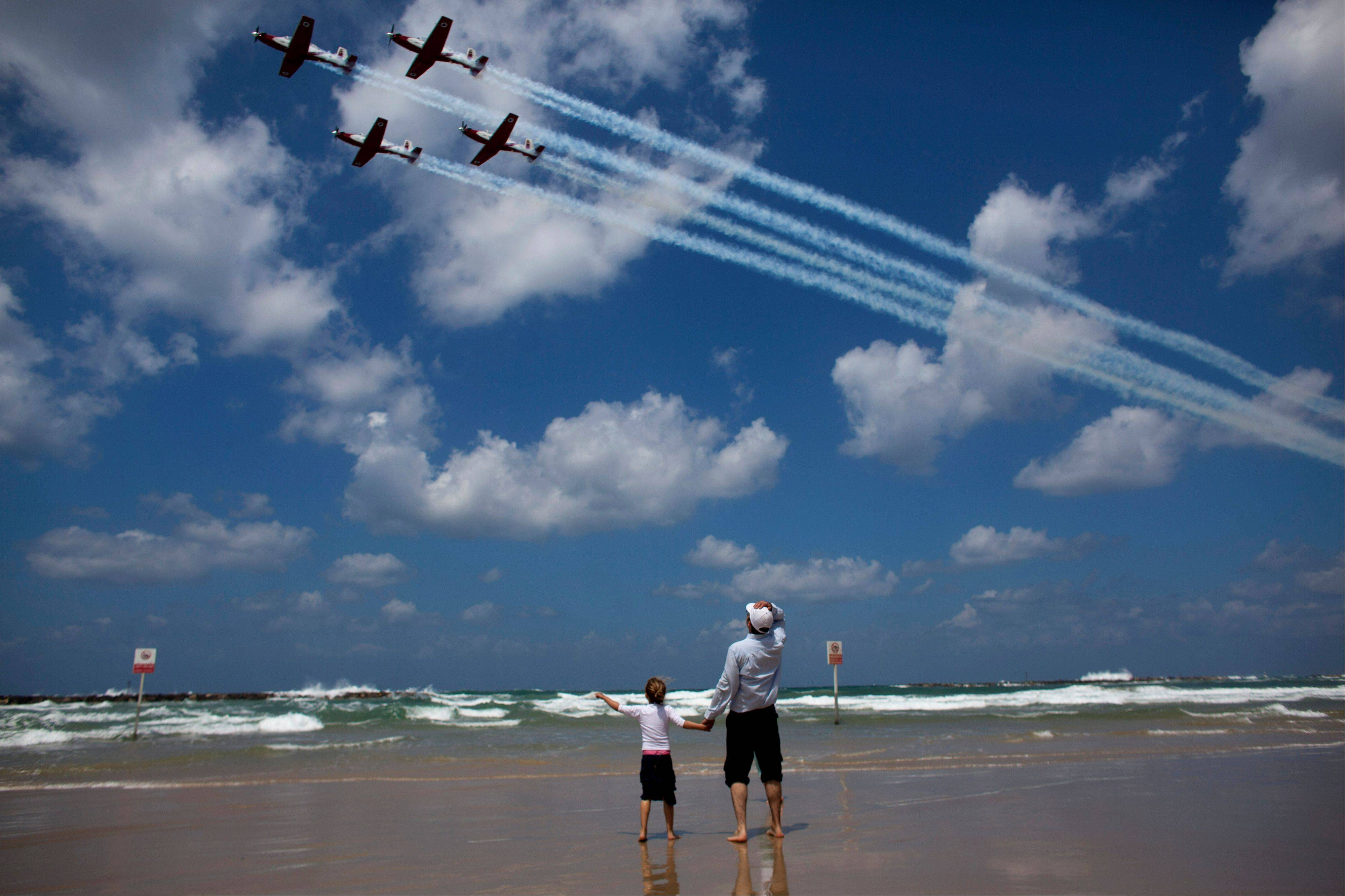 Israelis watch an air show Tuesday during Independence Day in Tel Aviv.
