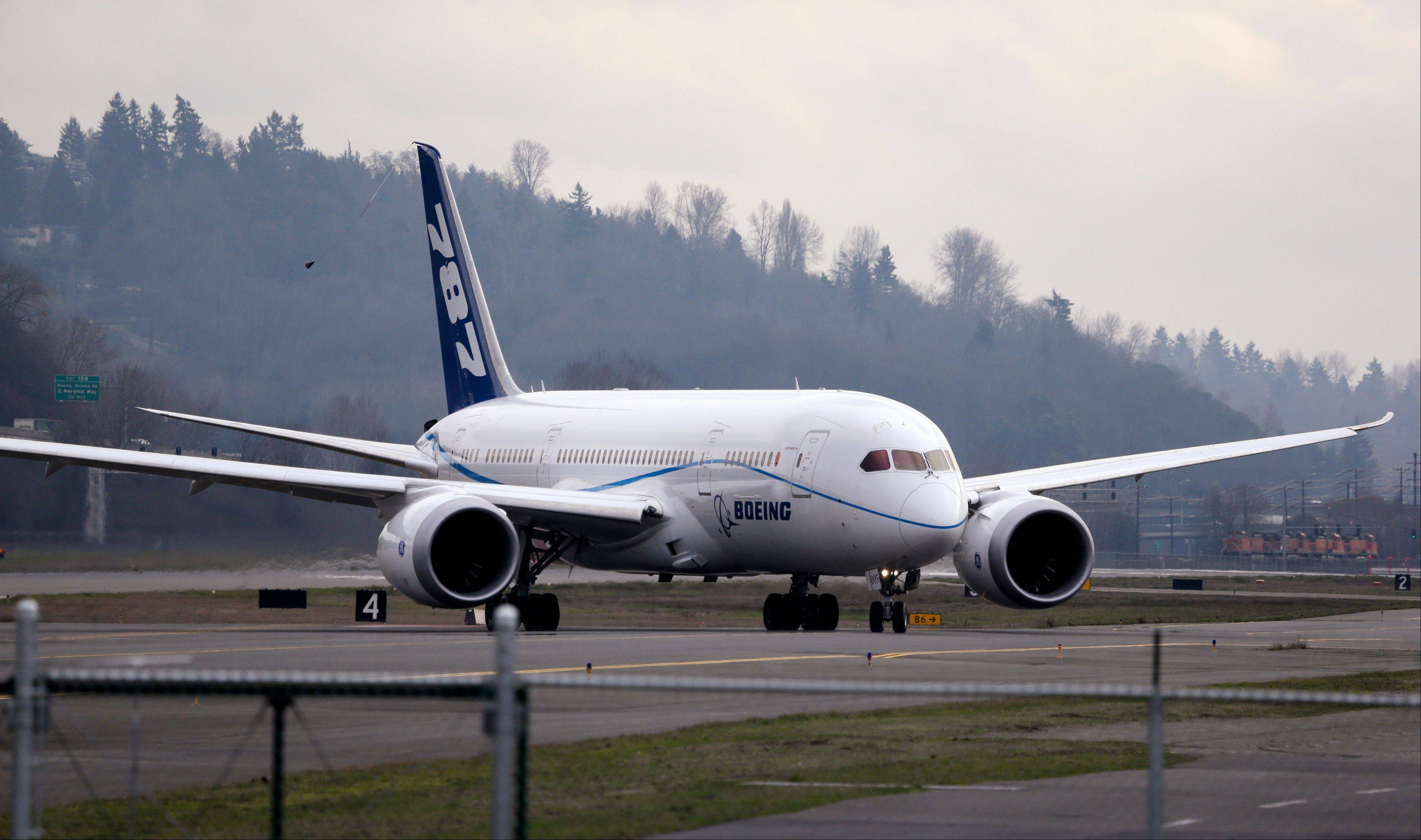 A Boeing 787 test jet taxies following a test flight, at Boeing Field, in Seattle.