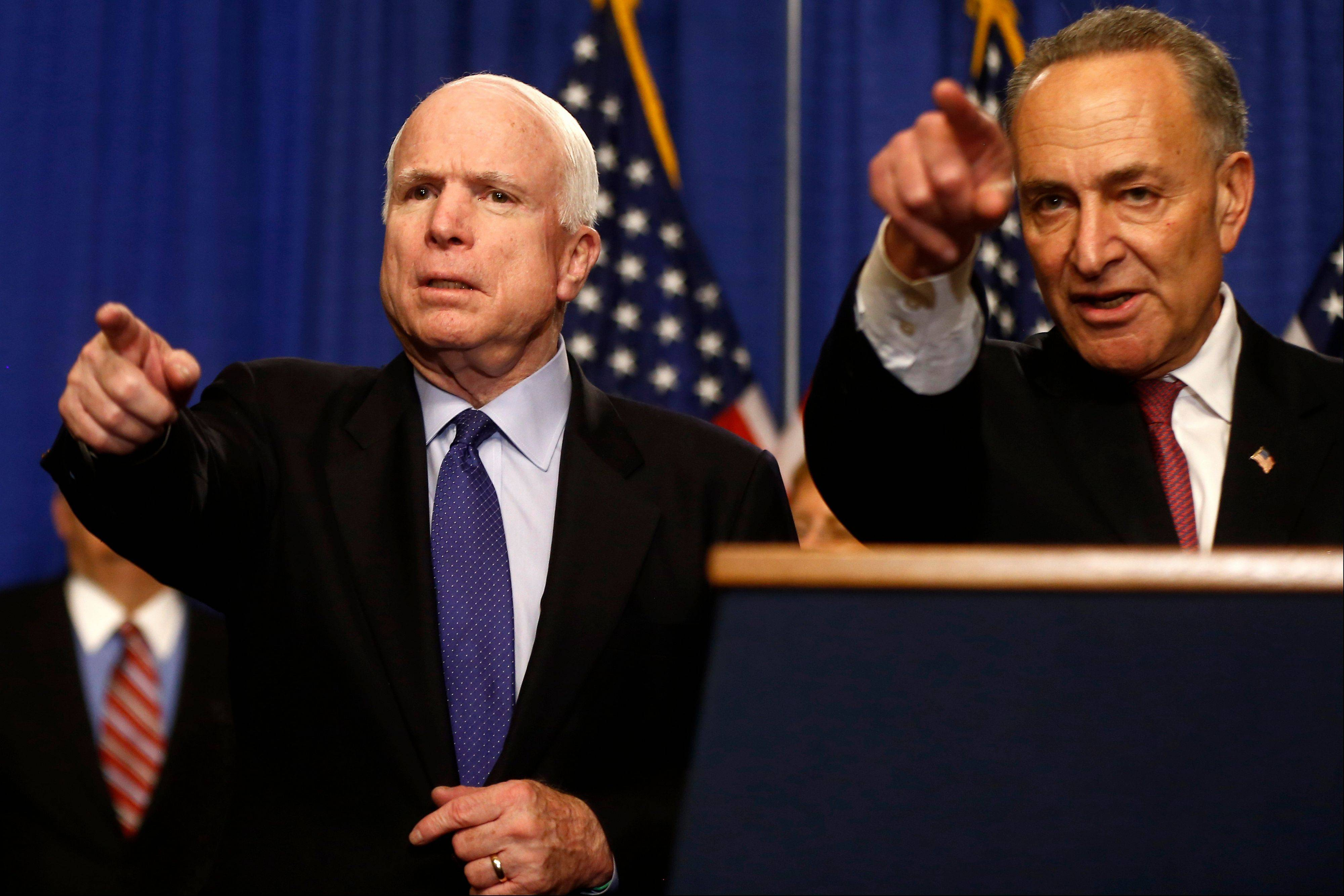 Sen. John McCain, R-Ariz., left, and Sen. Charles Schumer, D-N.Y. take questions during a news conference on immigration reform legislation, Thursday, April 18, 2013, on Capitol Hill in Washington.