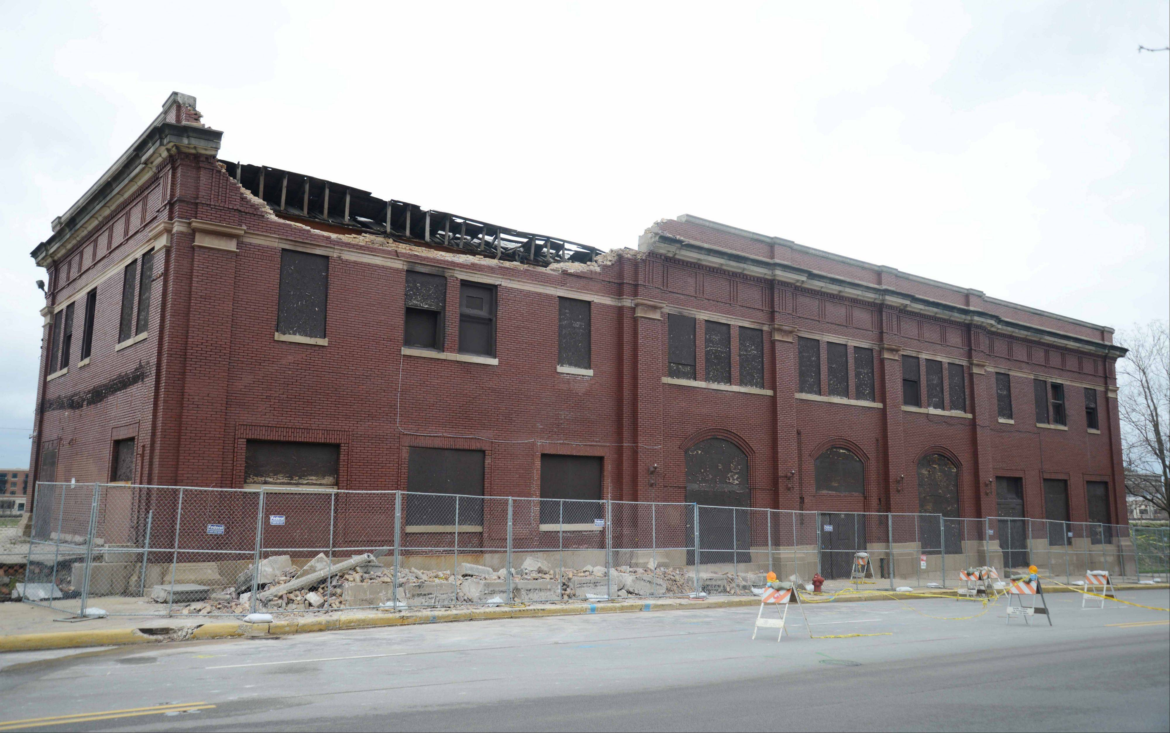 The roof of a former train depot on Broadway Avenue in Aurora collapsed, causing closure of the road for some of Friday. The building�s owner wants to demolish it.