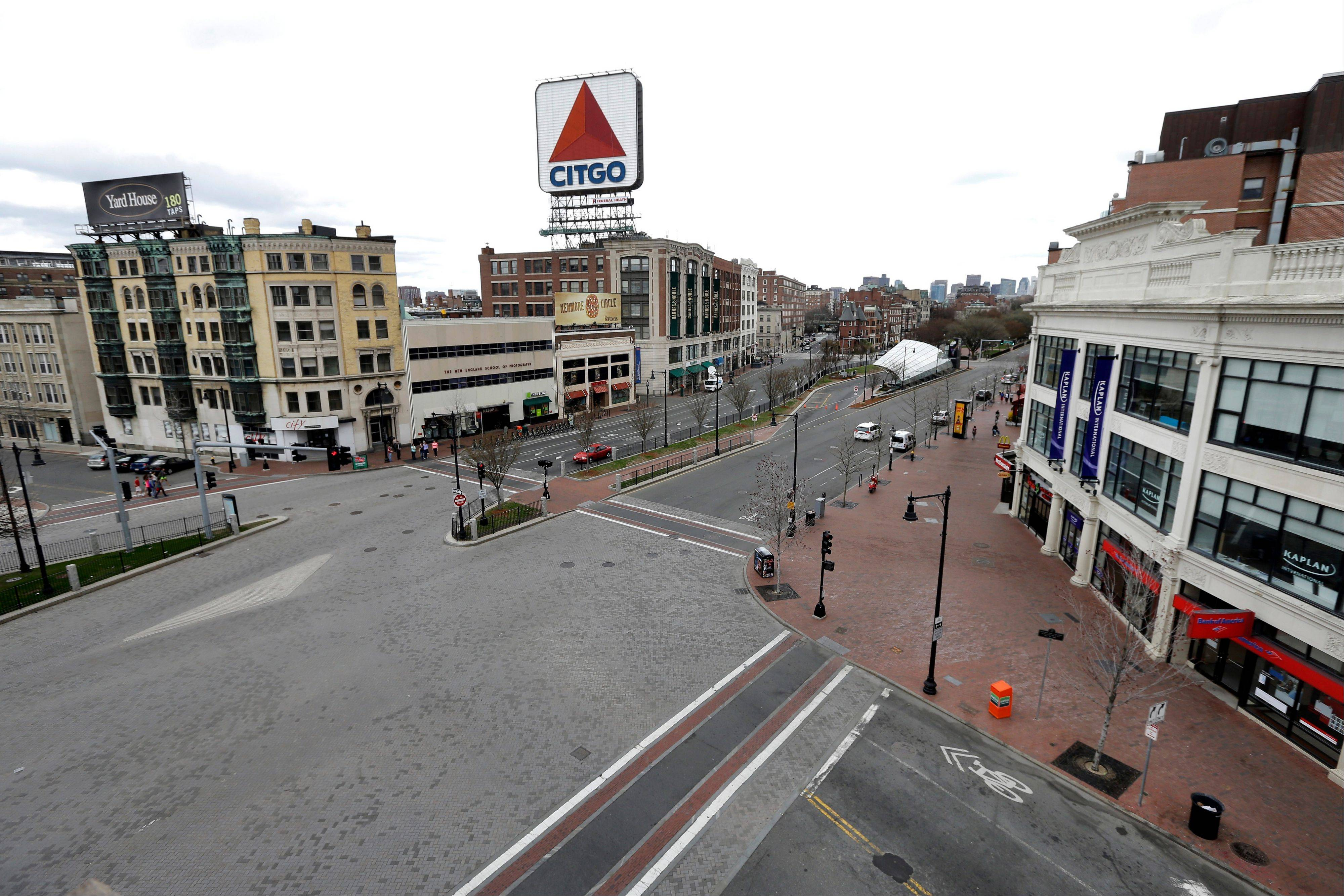 "The usually busy Kenmore Square in Boston is virtually deserted at lunchtime Fridayduring a call for ""shelter-in-place"" for Boston and some area communities."