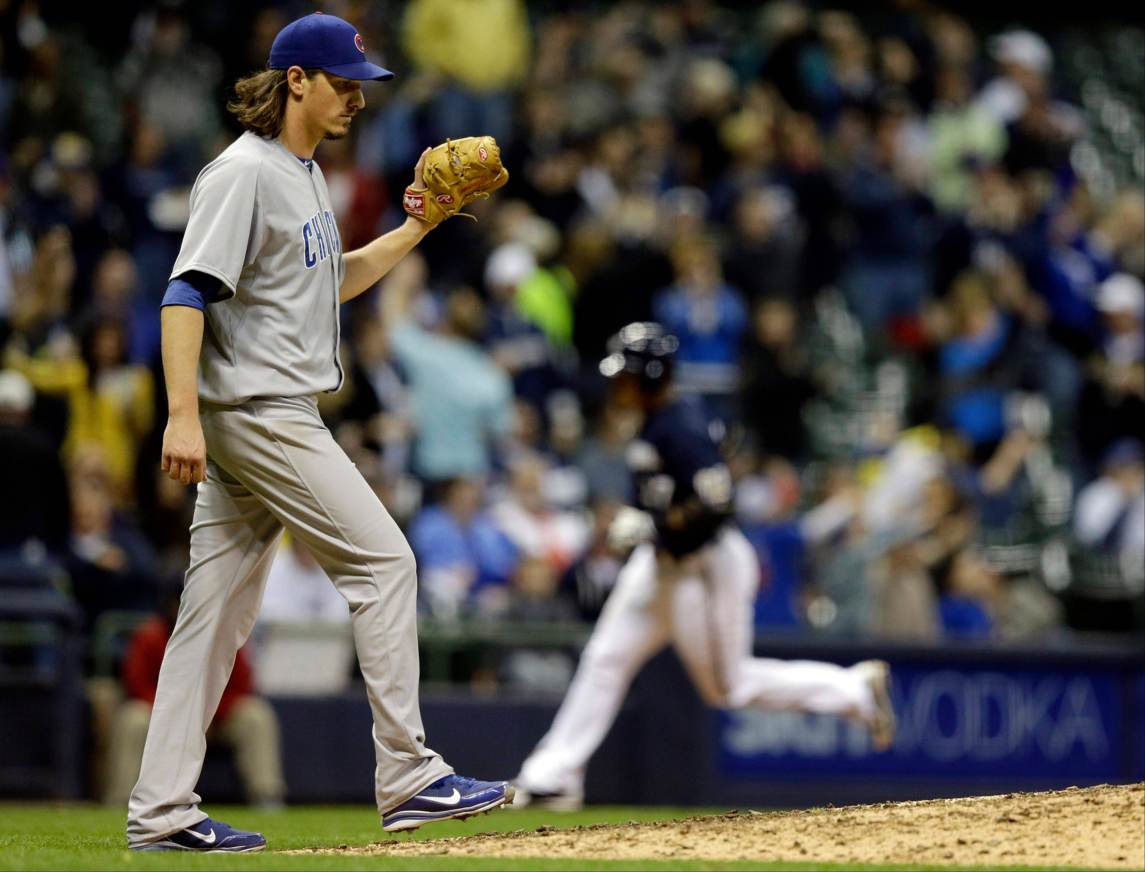 Chicago Cubs starting pitcher Jeff Samardzija reacts as Milwaukee Brewers' Carlos Gomez rounds the bases after hitting a home run during the seventh inning of a baseball game Friday, April 19, 2013, in Milwaukee. (AP Photo/Morry Gash)
